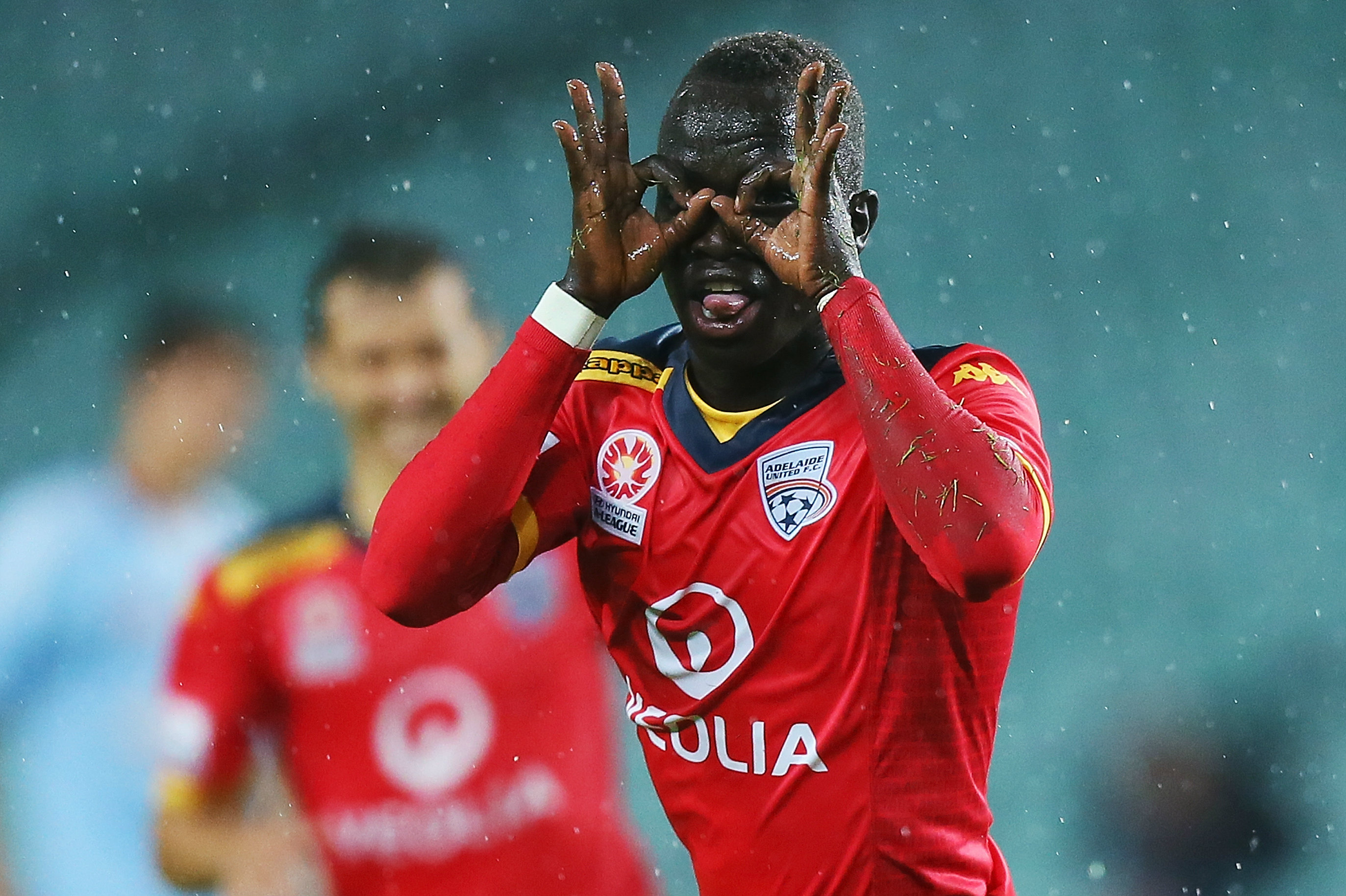 Awer Mabil celebrating a goal during his time at Adelaide United.