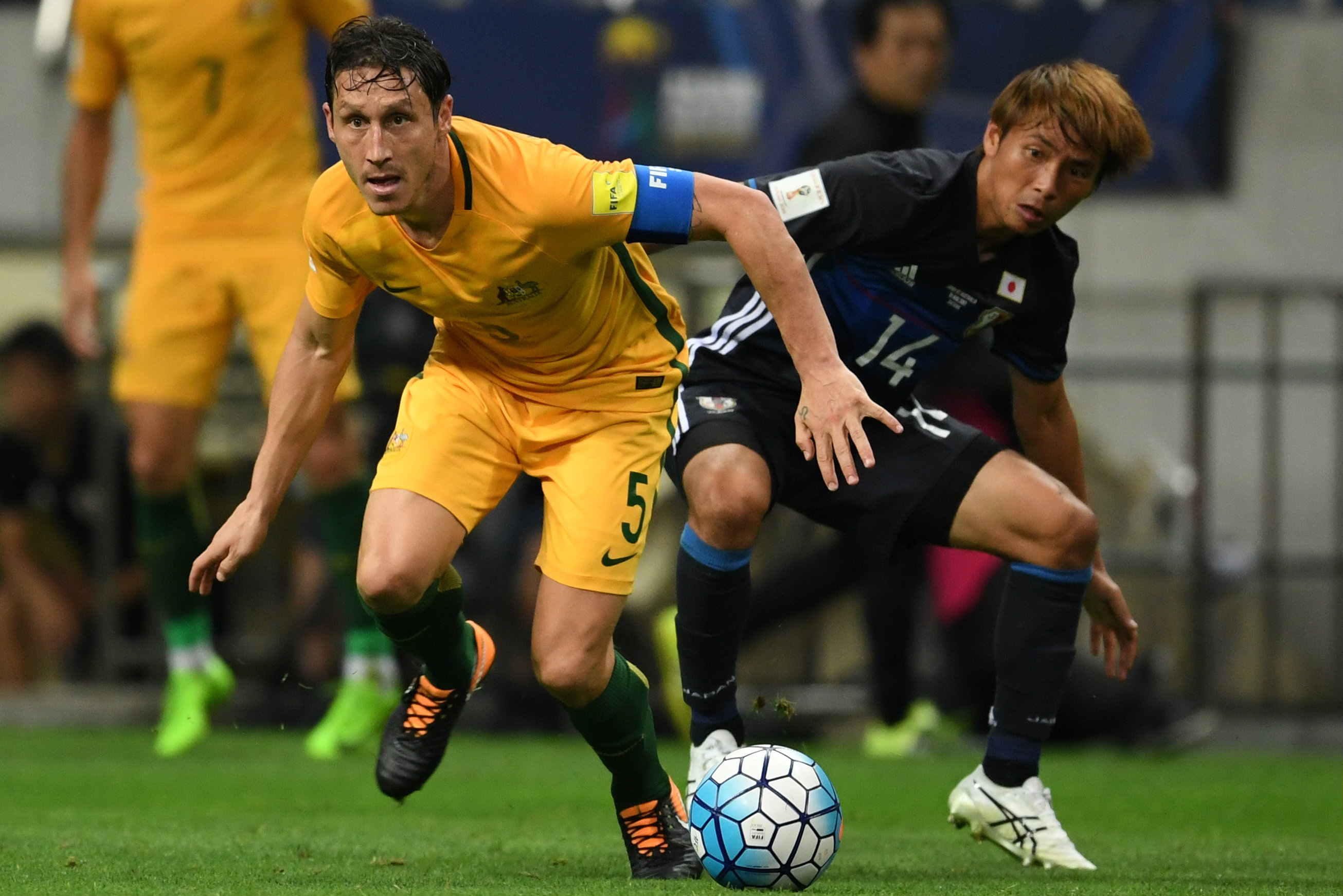 Mark Milligan on the ball against Japan.