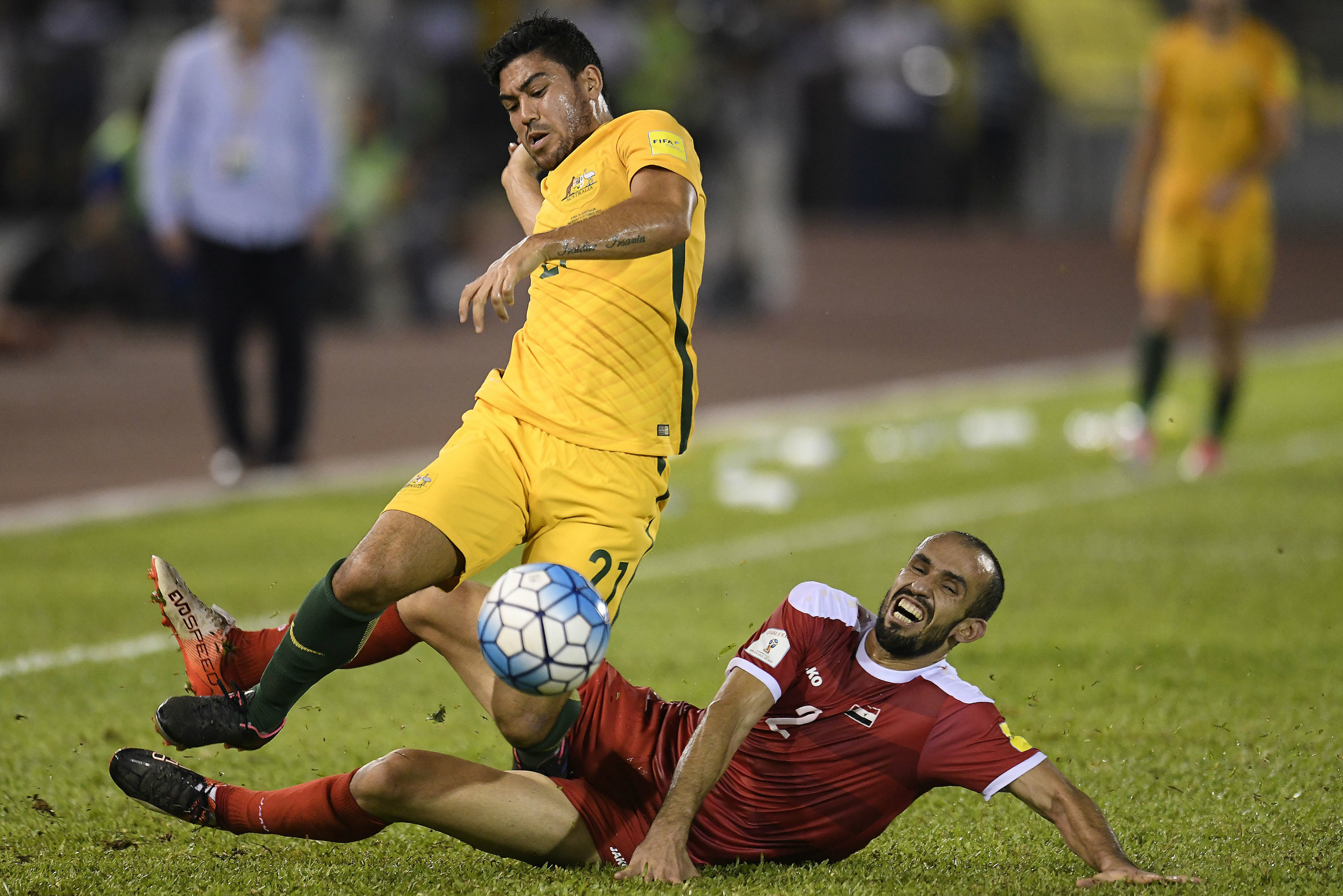 Massimo Luongo on the end of a tough challenge in Malaysia.