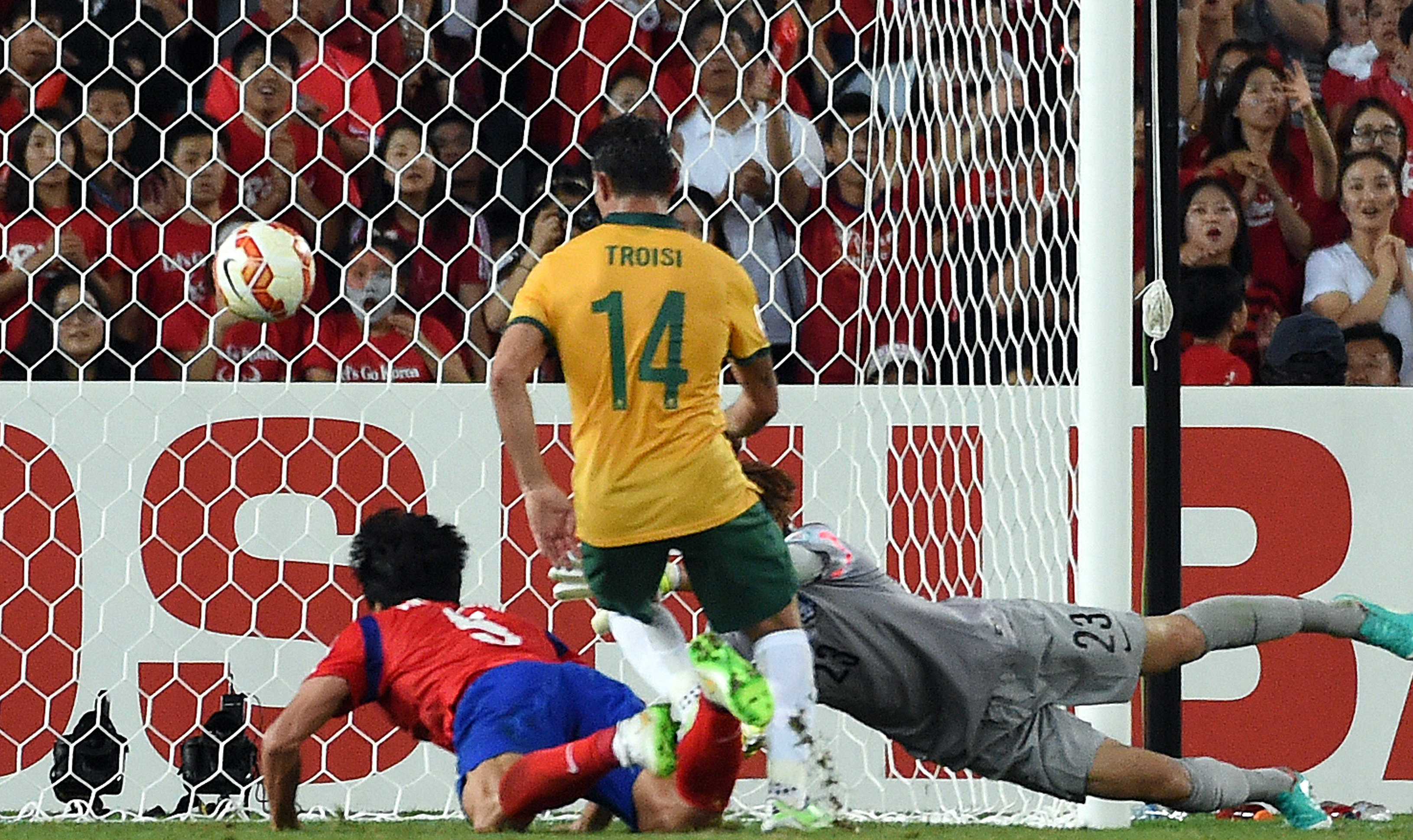 The moment. James Troisi sweeps home the winning goal against South Korea.