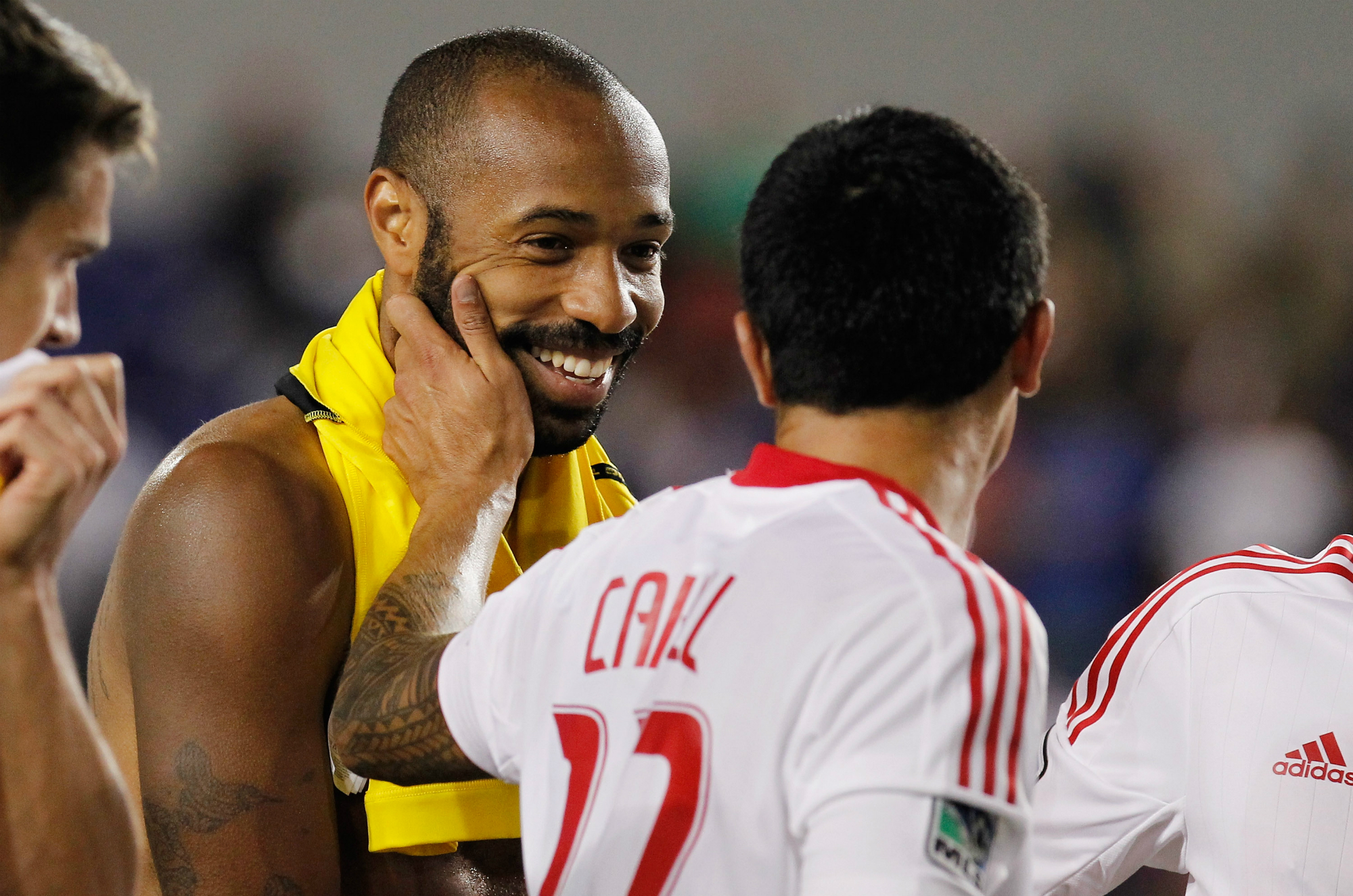 Thierry Henry and Tim Cahill