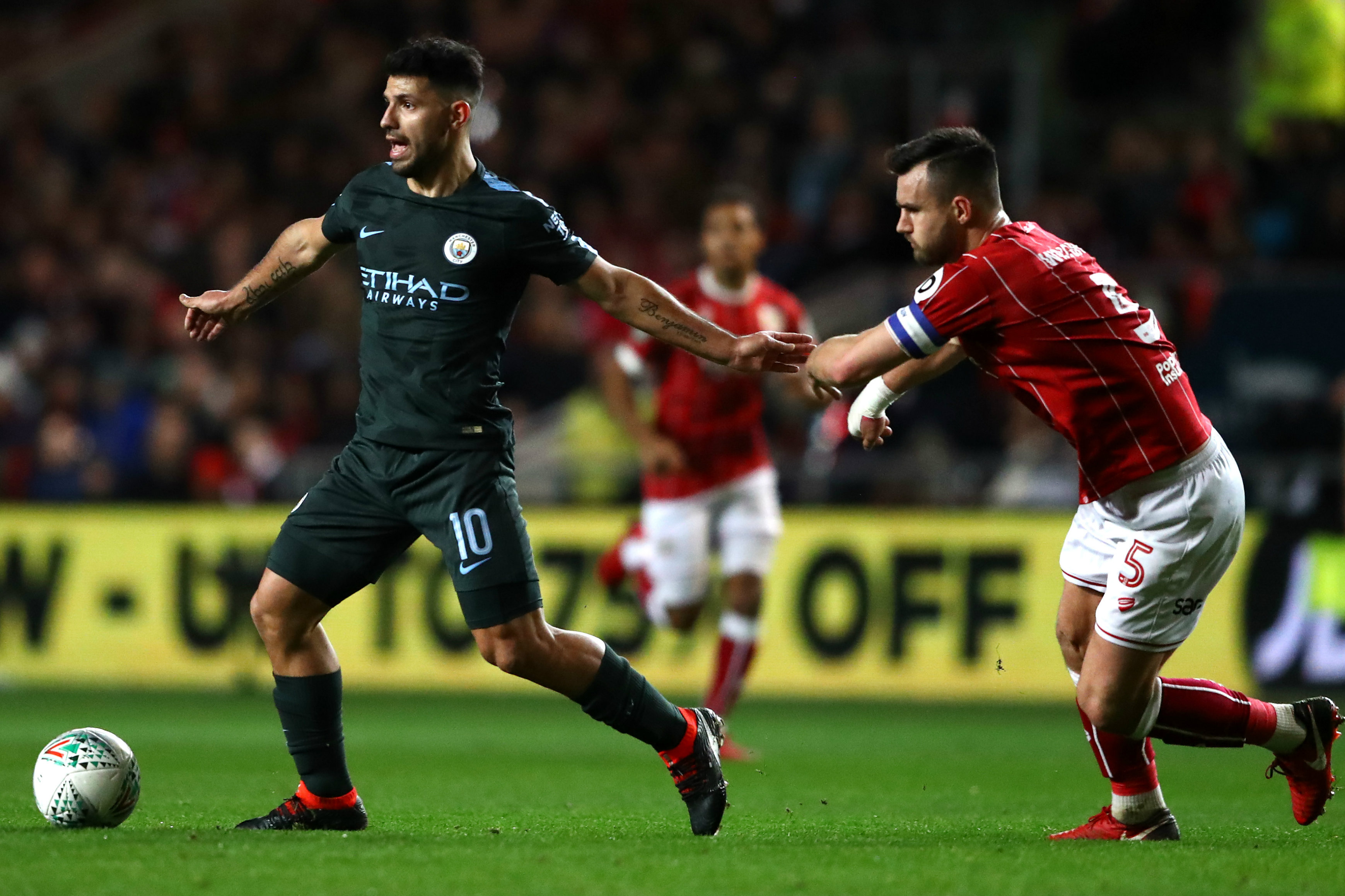 Bailey Wright puts the pressure on City star Sergio Aguero.