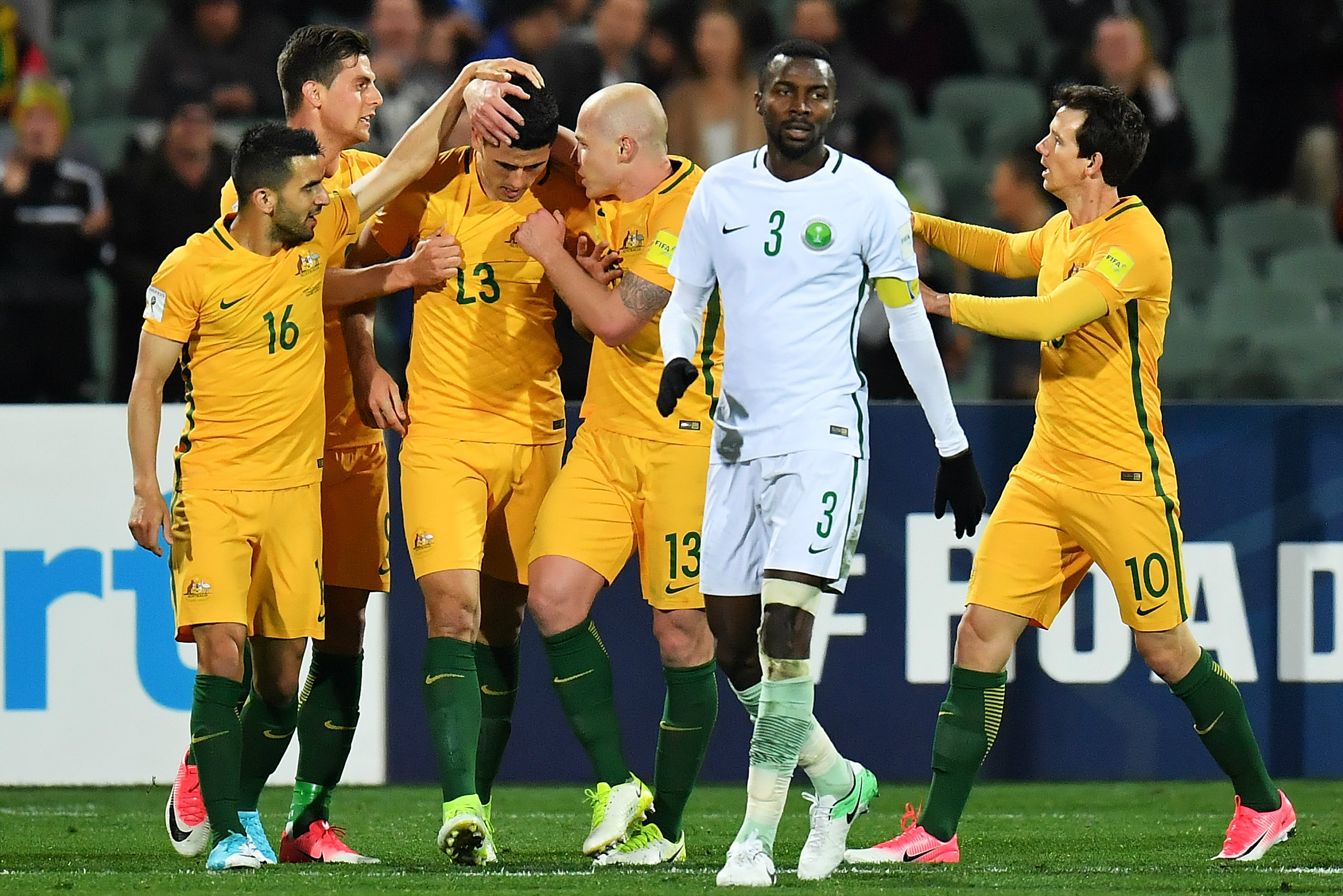 The Caltex Socceroos celebrate Tom Rogic's winner in Adelaide.