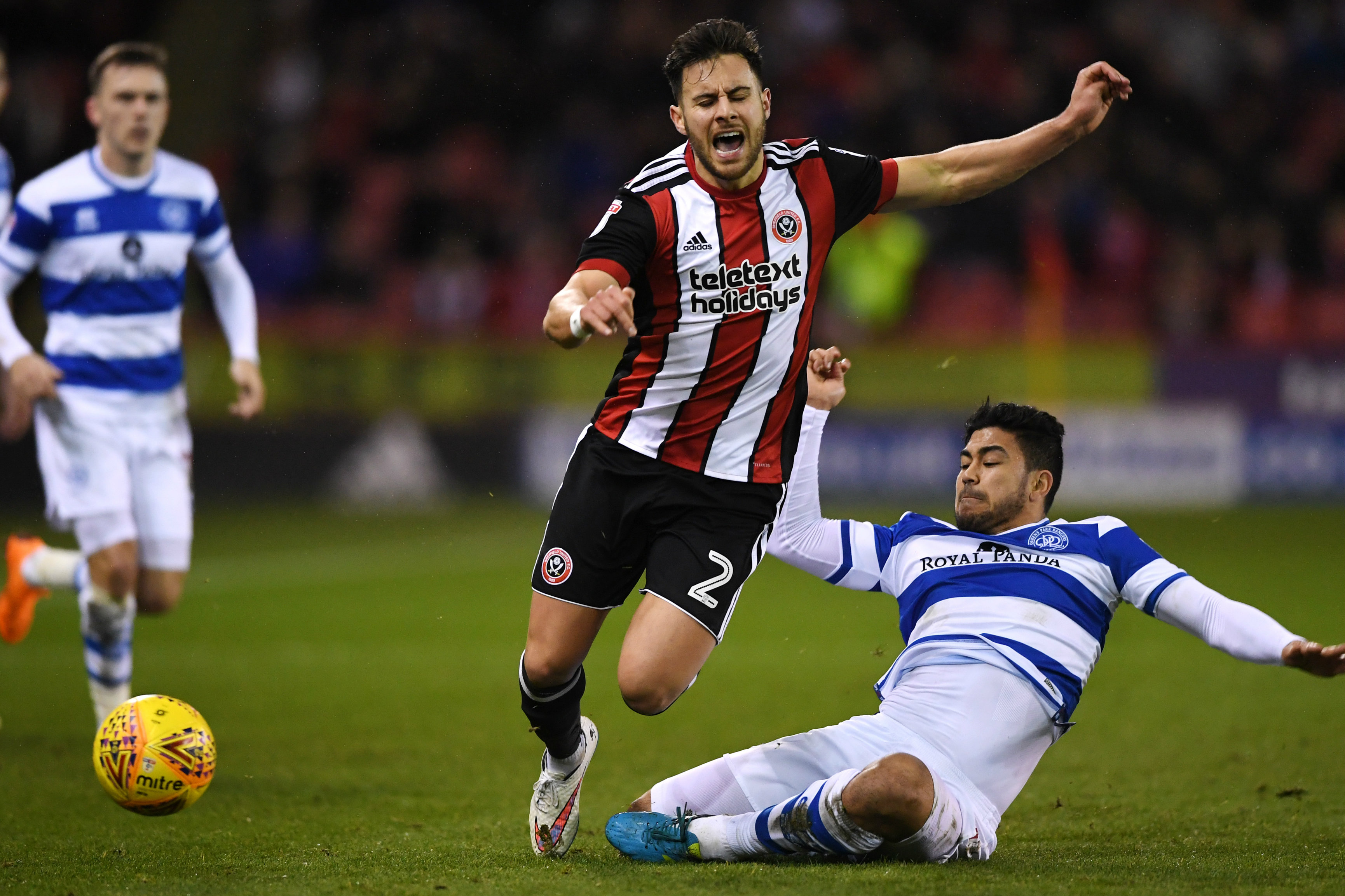 Massimo Luongo gets a tackle in on his Sheffield United opponent.
