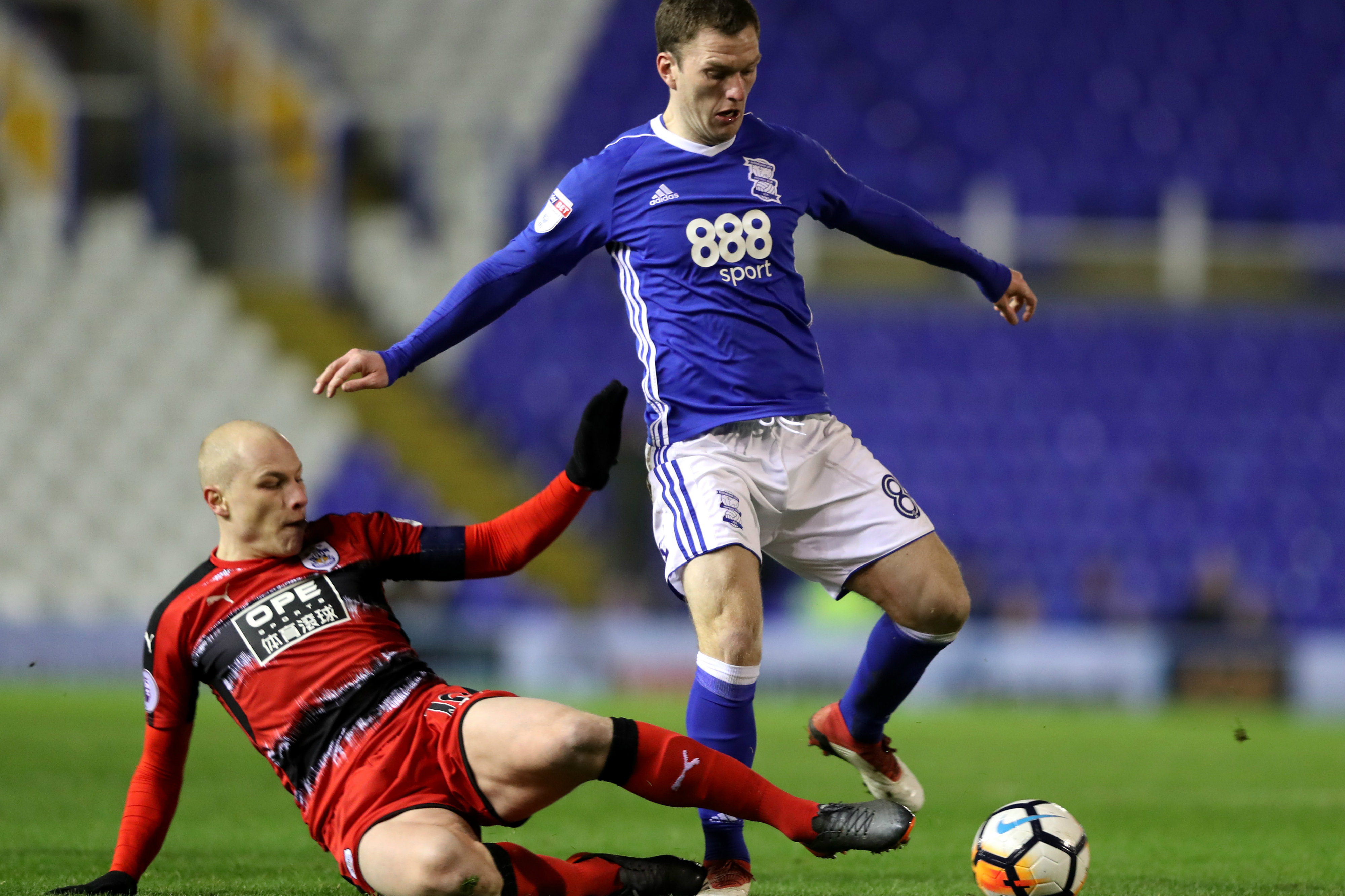 Aaron Mooy gets a tackle in on Birmingham's Craig Gardner.