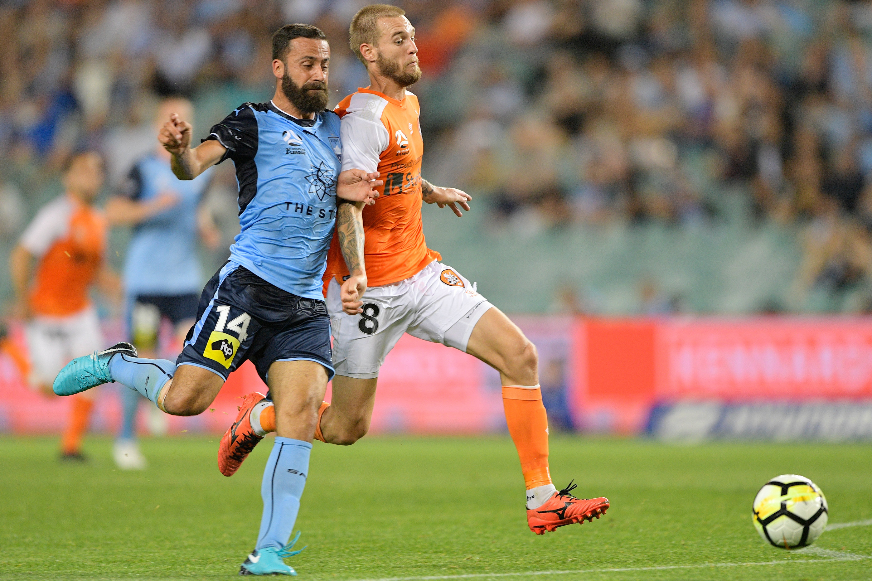Jacob Pepper in a battle for the ball with Sydney FC skipper Alex Brosque.