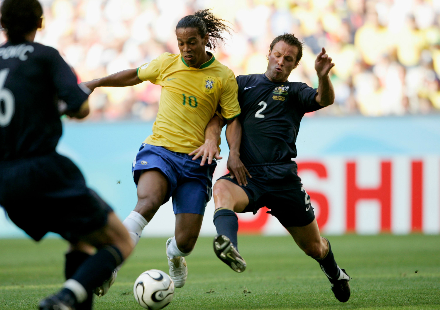 Lucas Neill and Ronaldinho