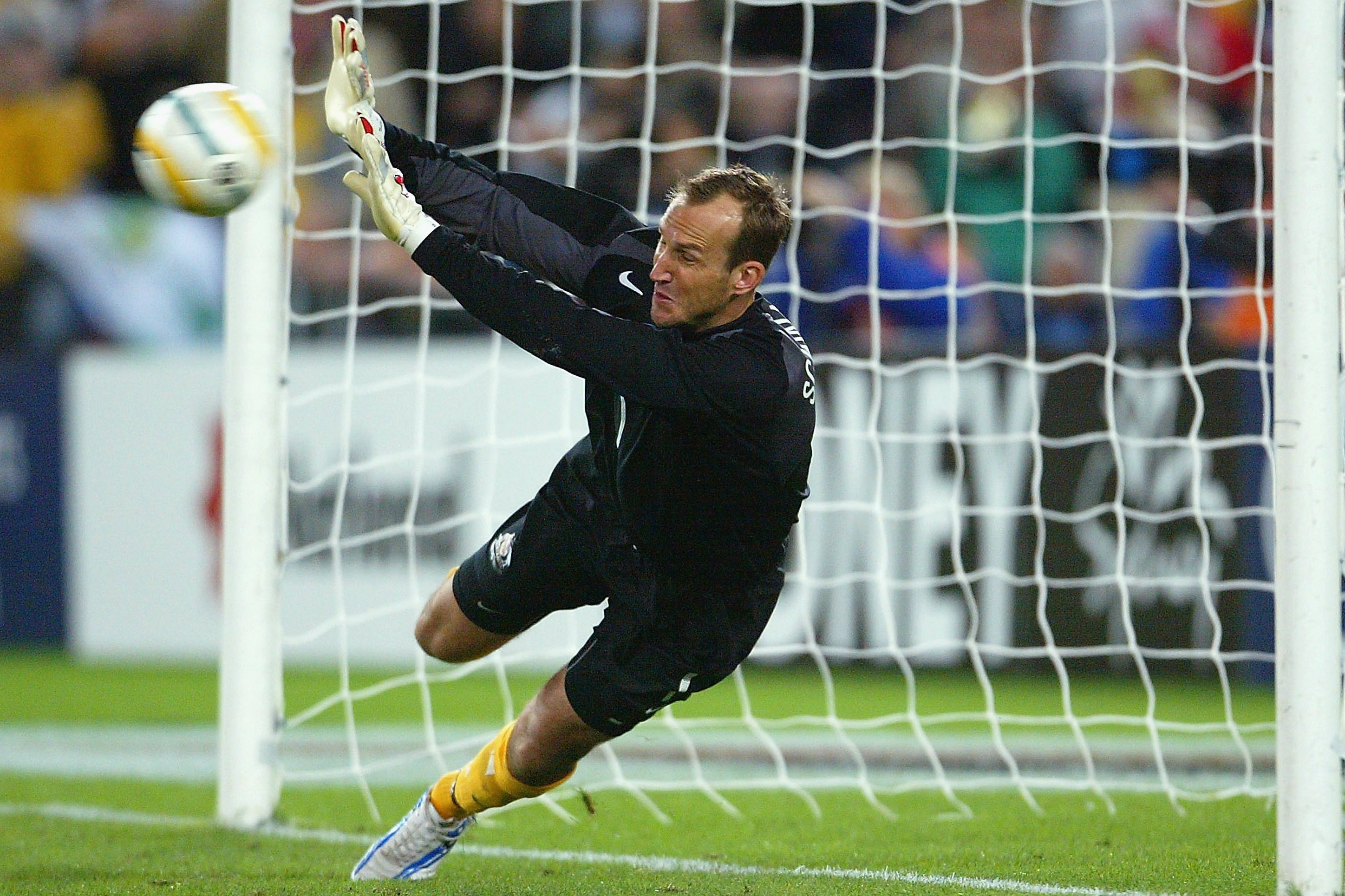 Mark Schwarzer makes a save in the shootout against Uruguay in 2005.