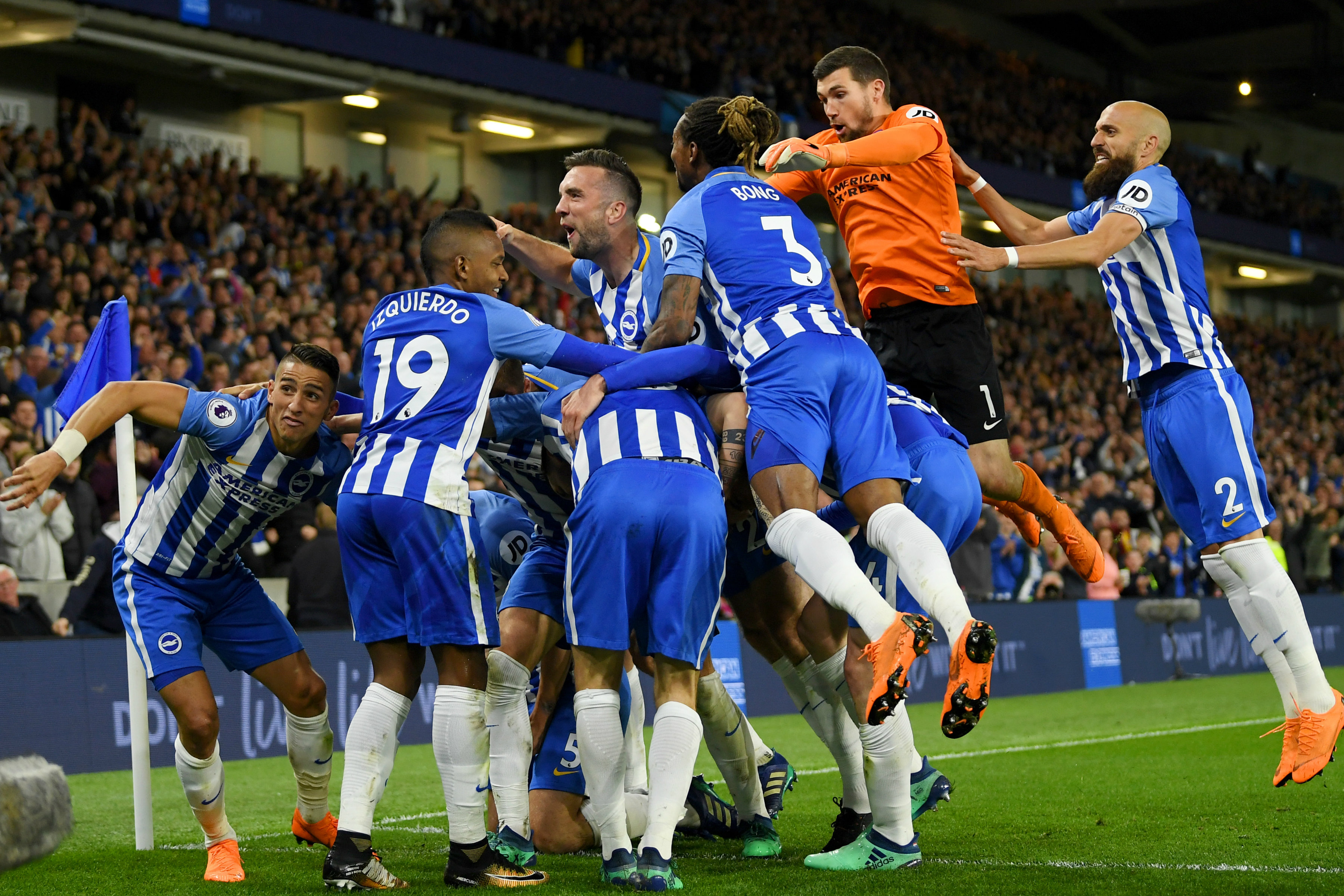 Brighton players celebrate Pascal Gross' winning goal.