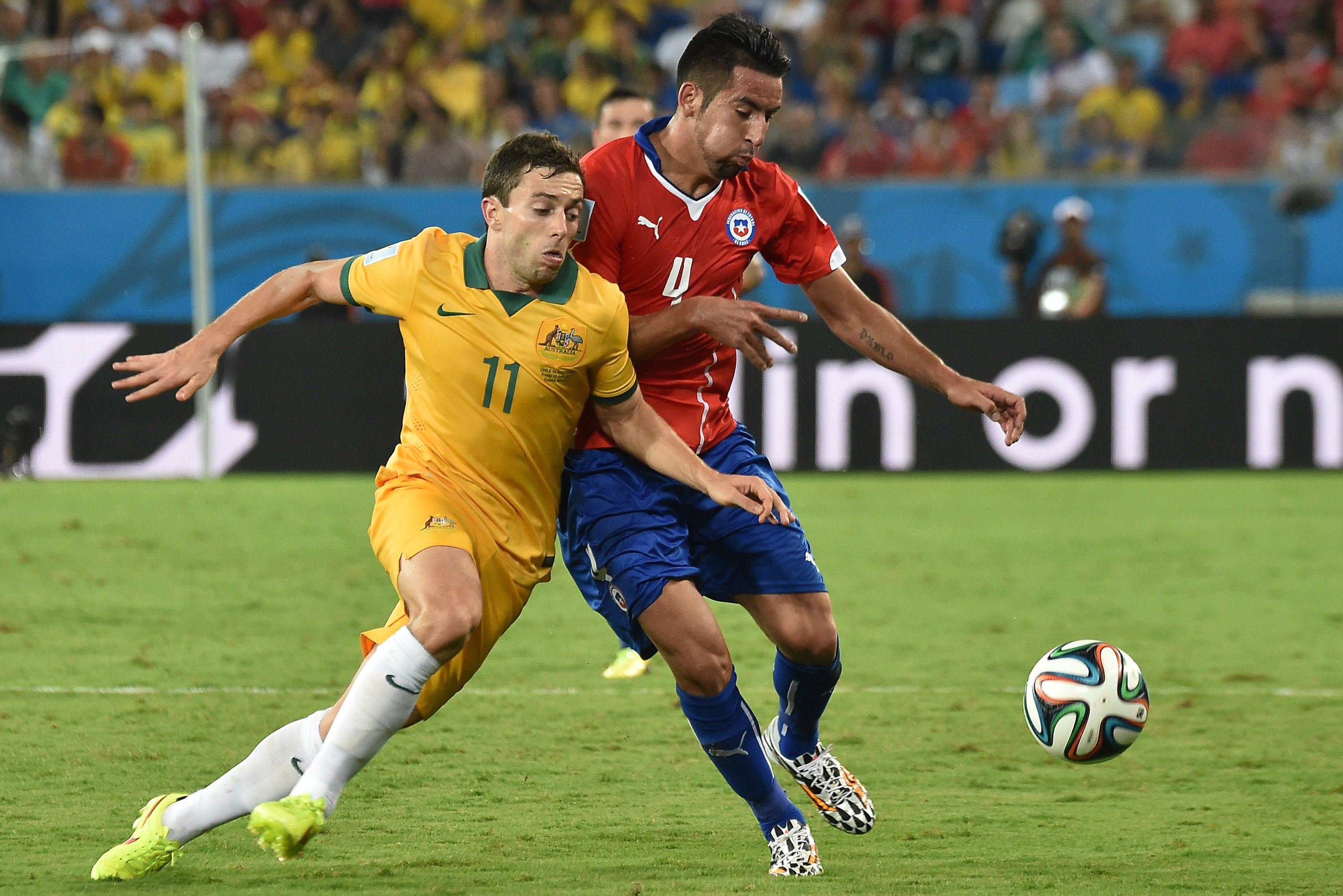 Tommy Oar  in action against Chile.