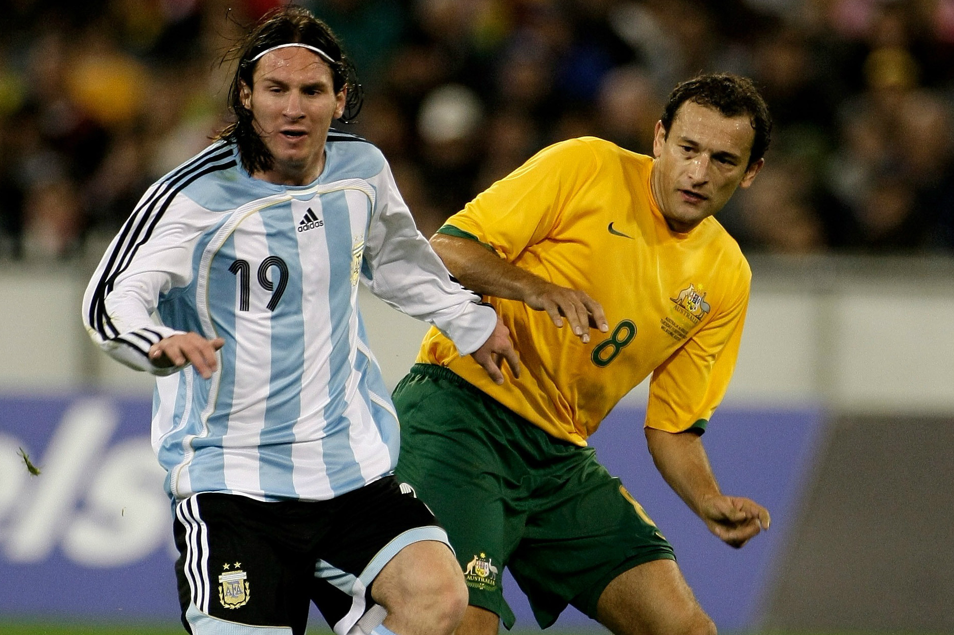 Josip Skoko up against Argentina superstar Lionel Messi.
