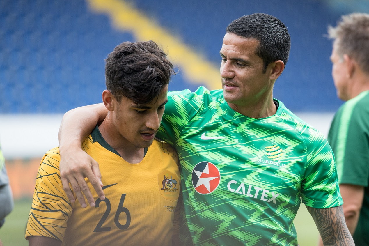 Tim Cahill with Daniel Arzani