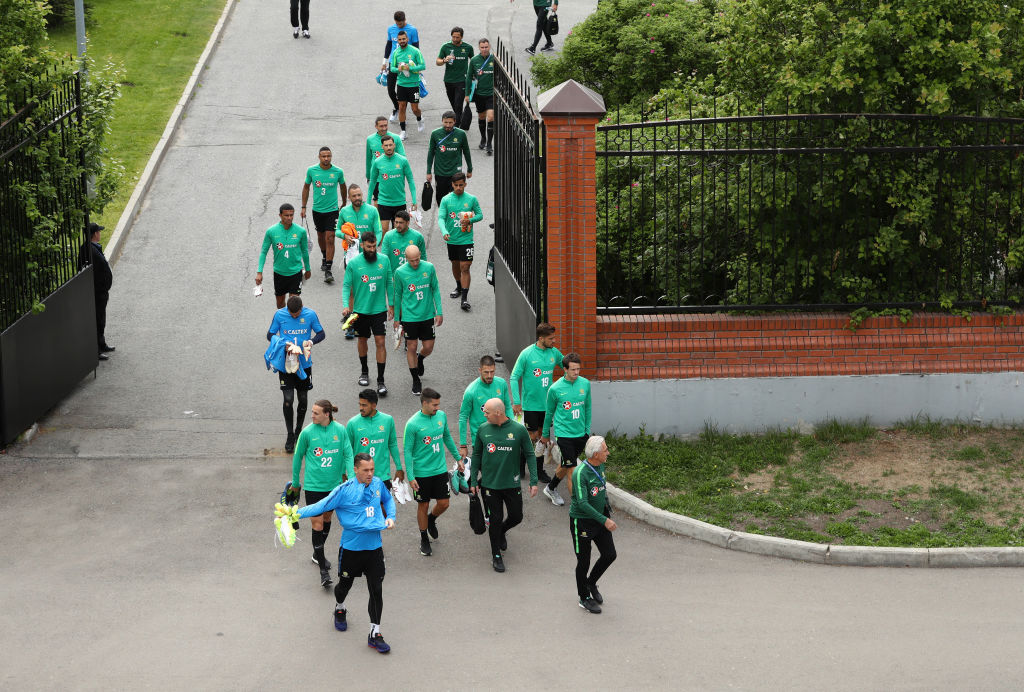 Caltex Socceroos players walk from the hotel to the training stadium