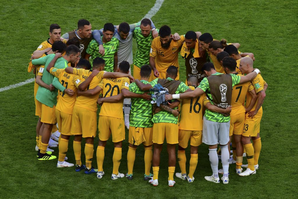 Socceroos players huddle after the France game