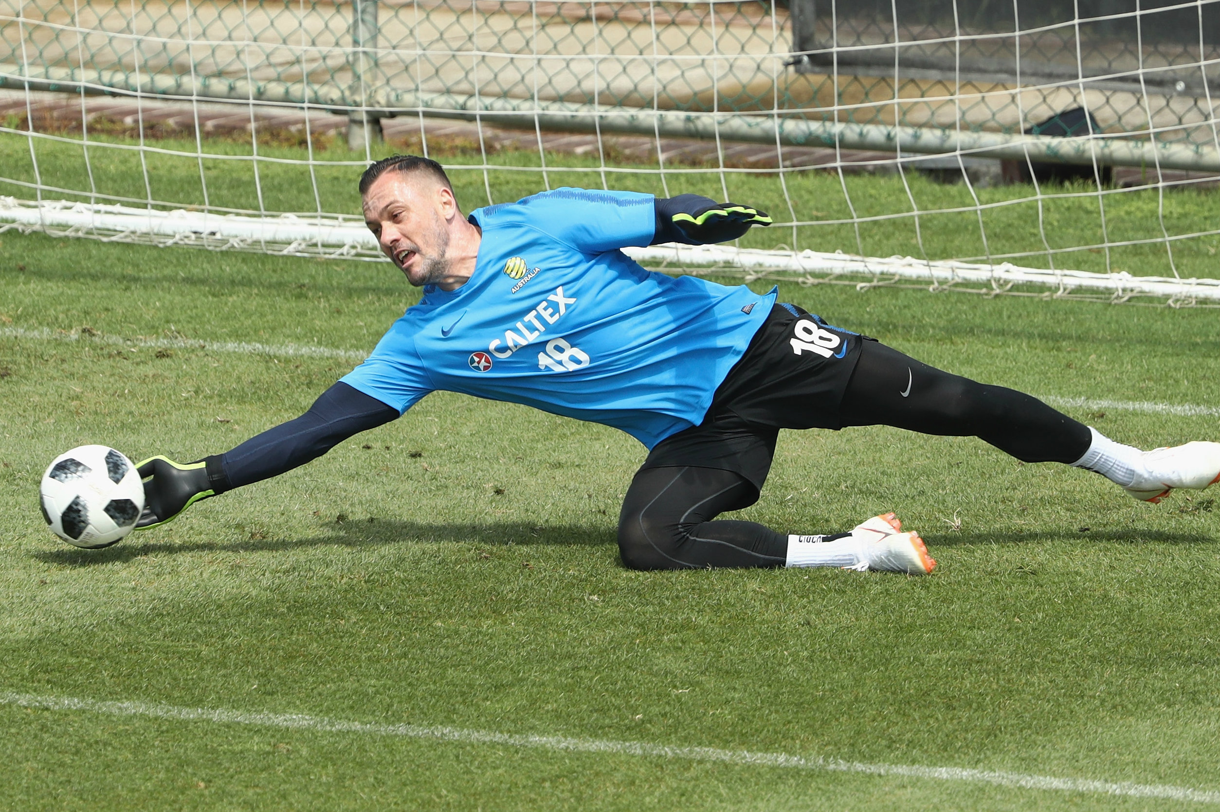 Danny Vukovic gets down low to make a save.