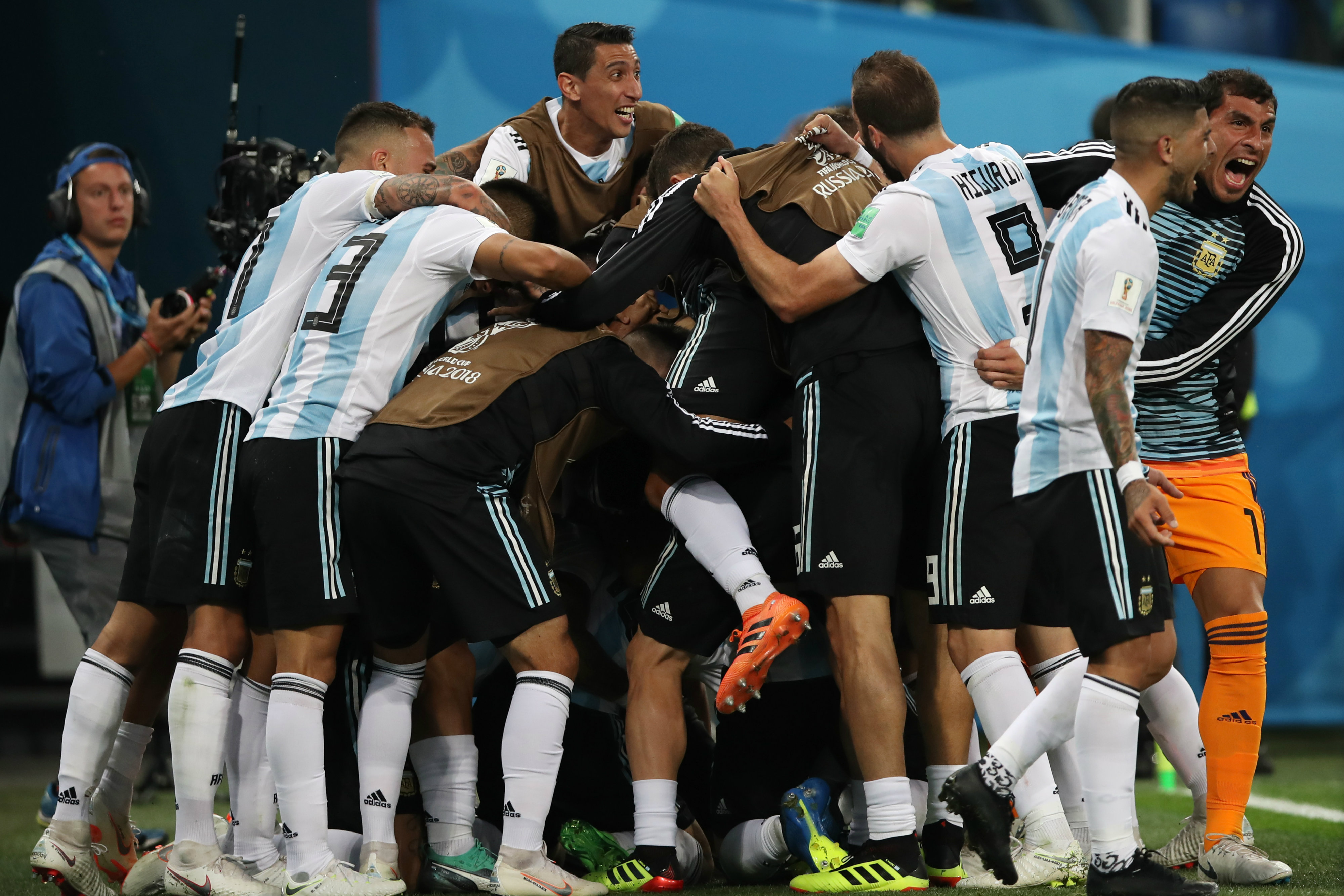 Argentina players swamp Marcos Rojo after his winning goal.