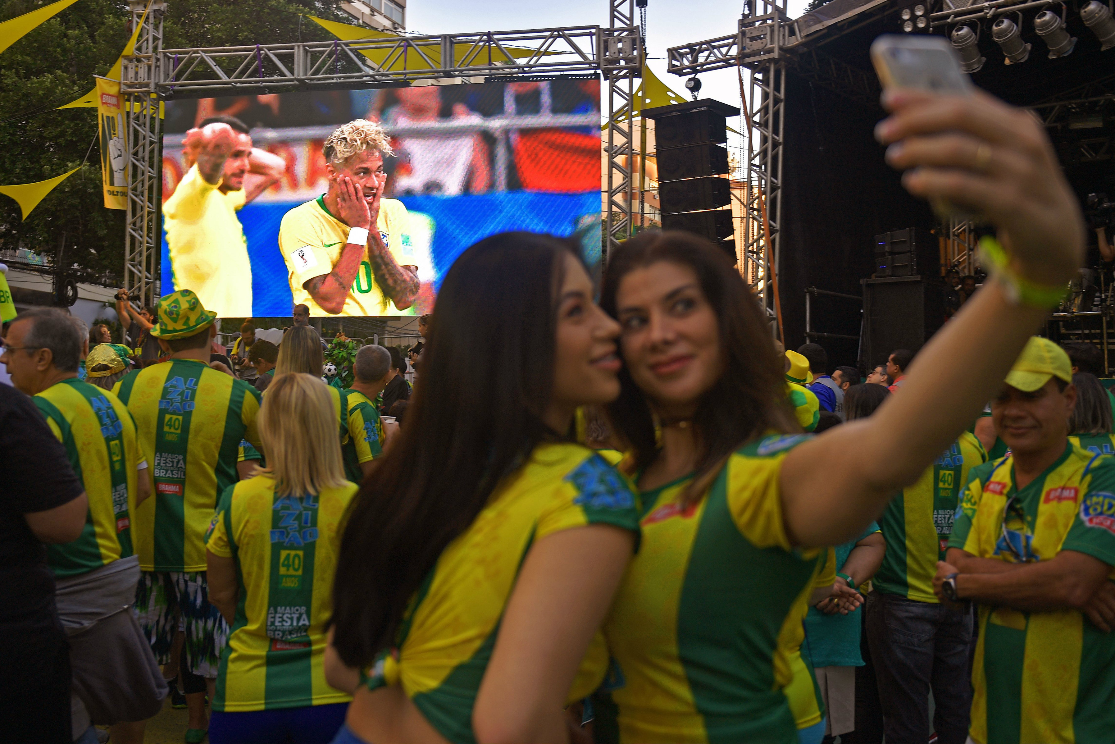A couple of Brazil fans take a selfie at one of the FIFA Fan Fests.