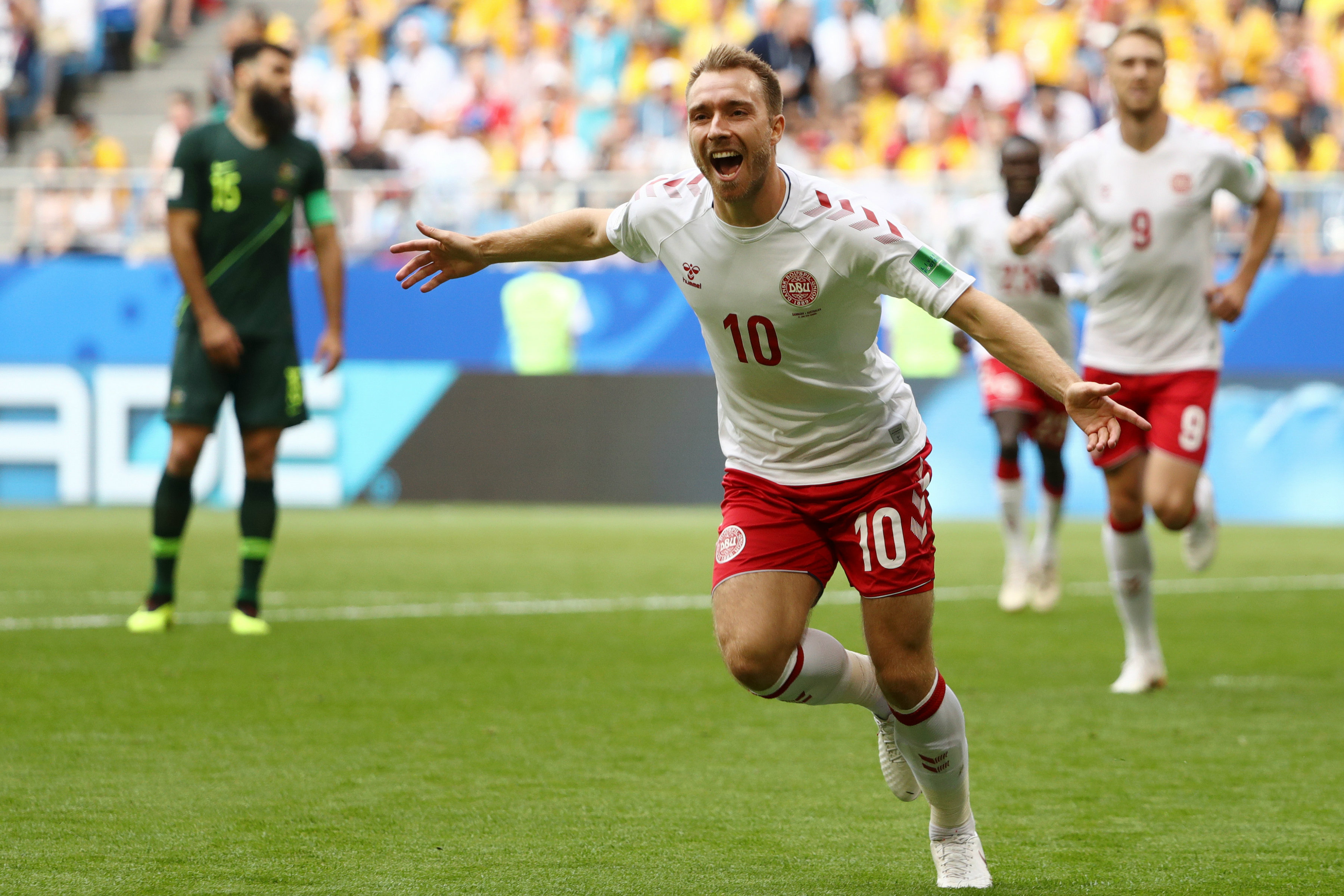Christian Eriksen celebrates opening the scoring against the Socceroos.