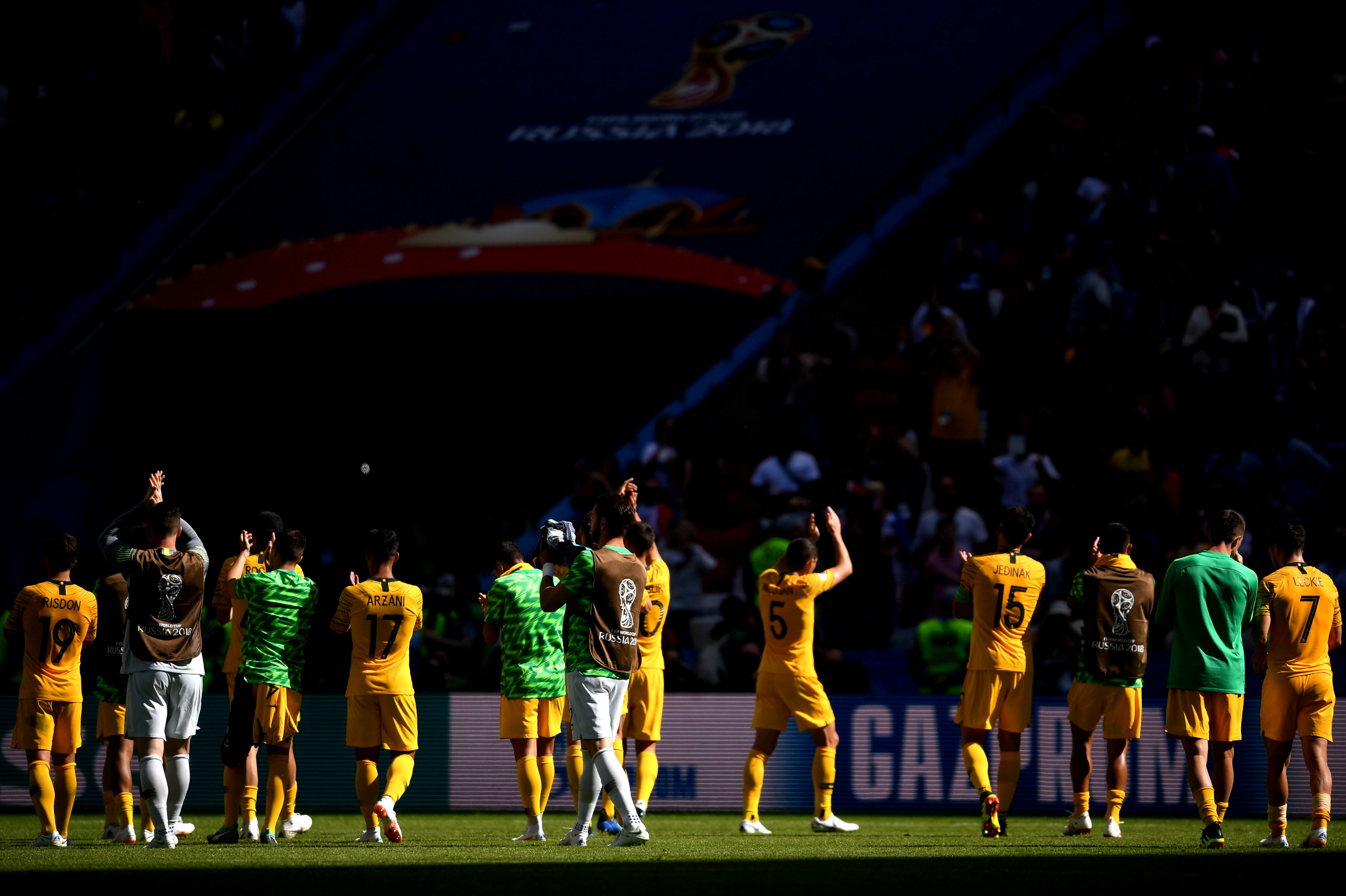 Socceroos players thank the fans for their support inside the Kazan Arena.
