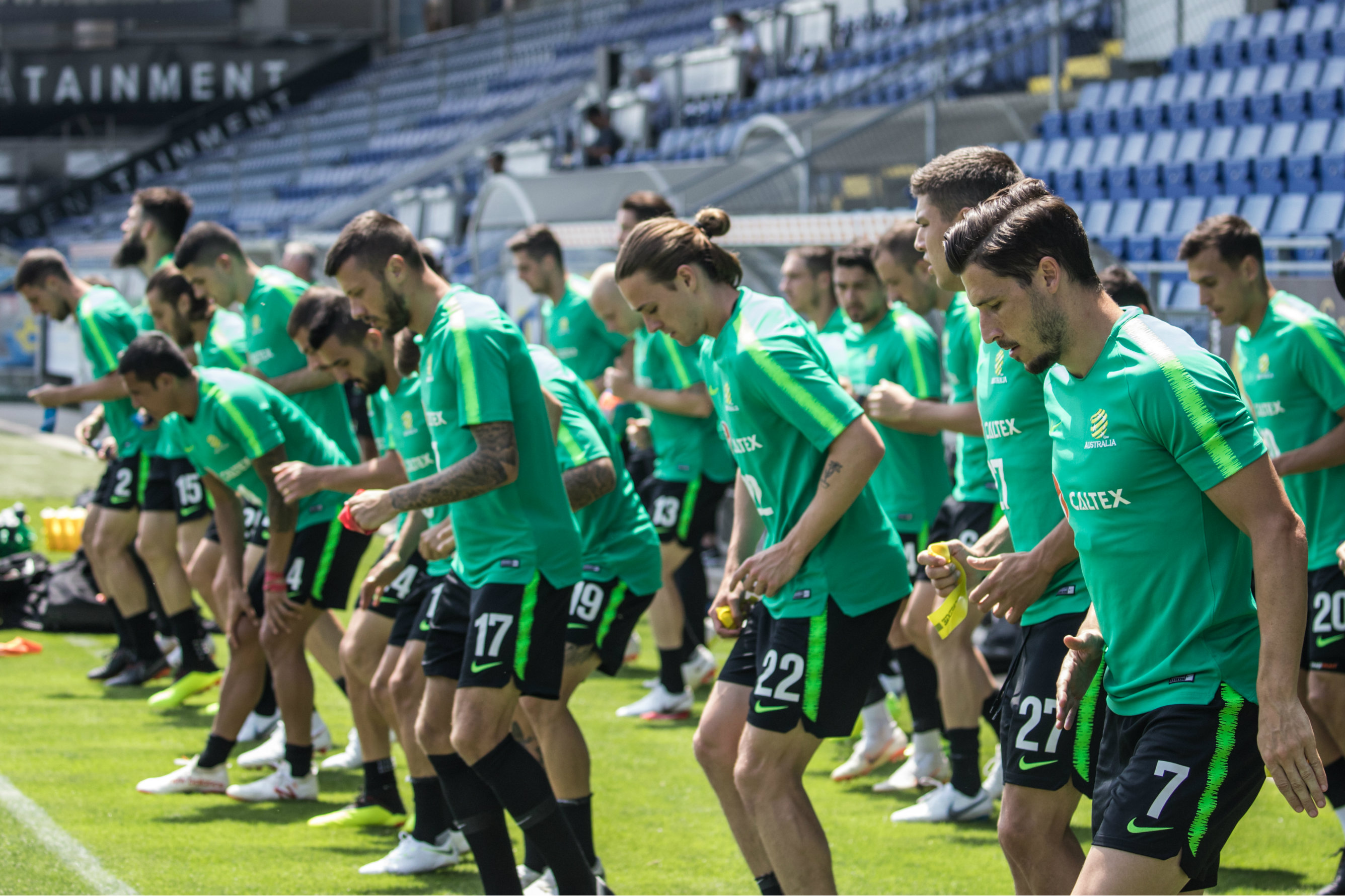 The Caltex Socceroos warm up before starting training.