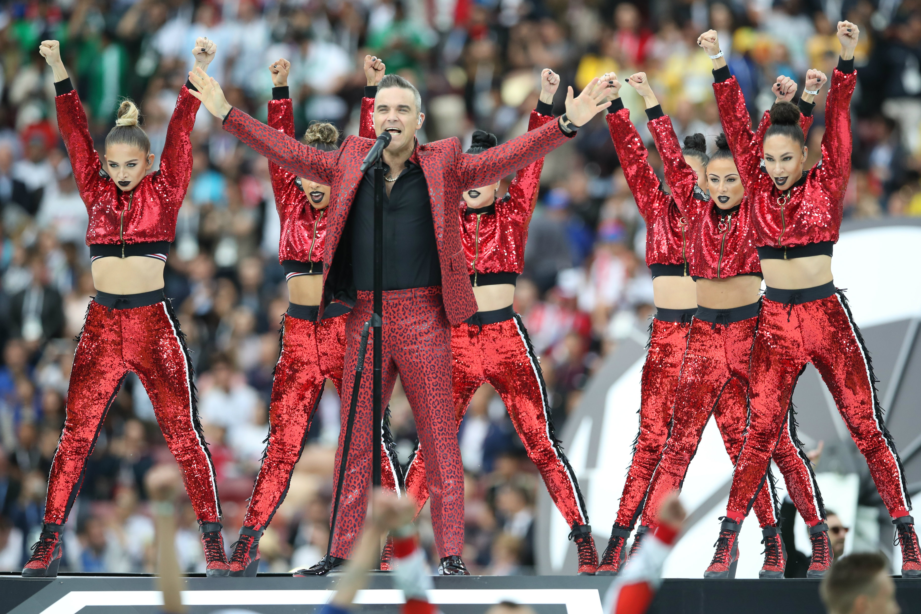 Robbie Williams performs at the opening ceremony of the 2018 FIFA World Cup™ .