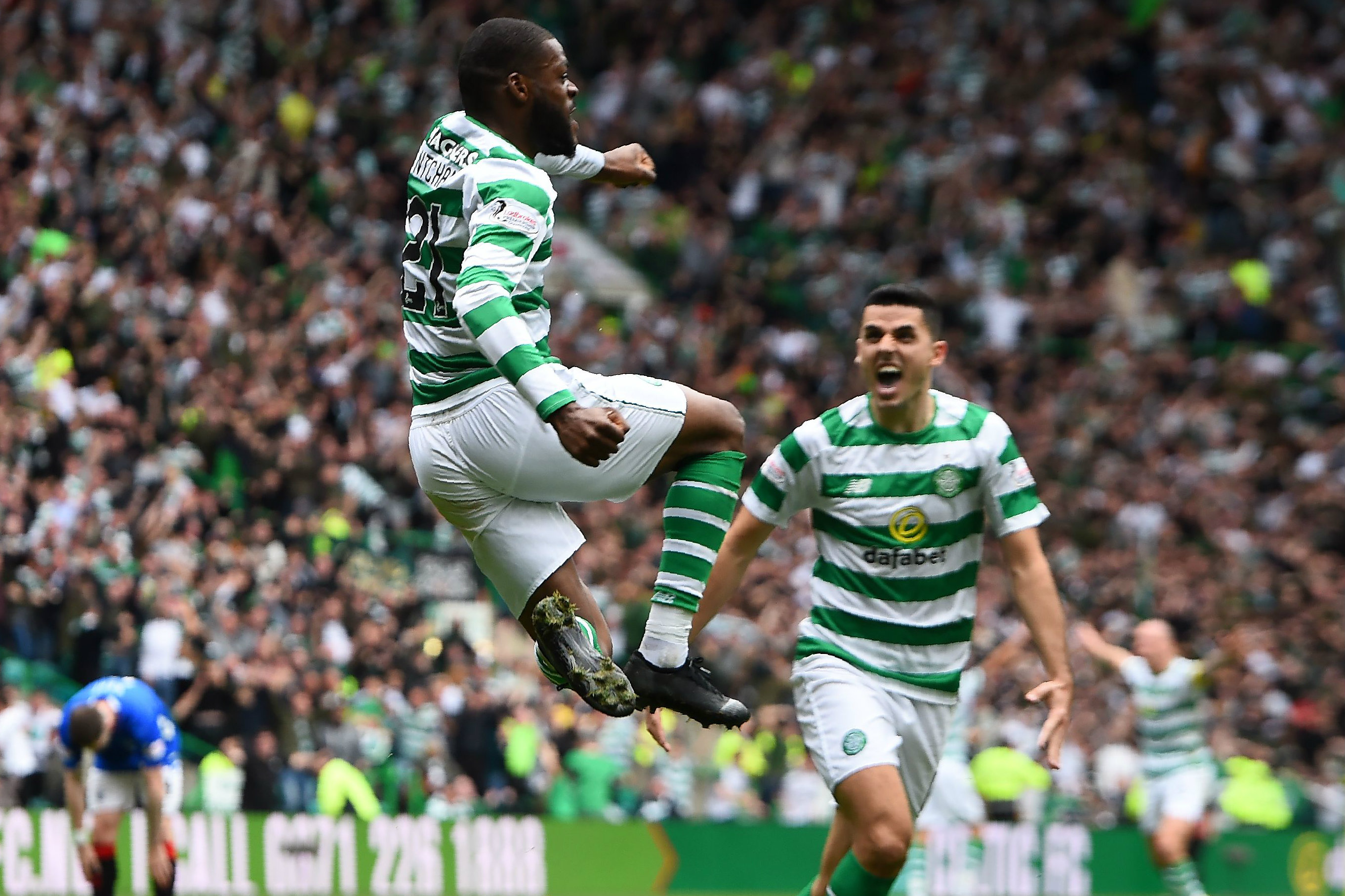 Tom Rogic celebrates Olivier Ntcham's goal.