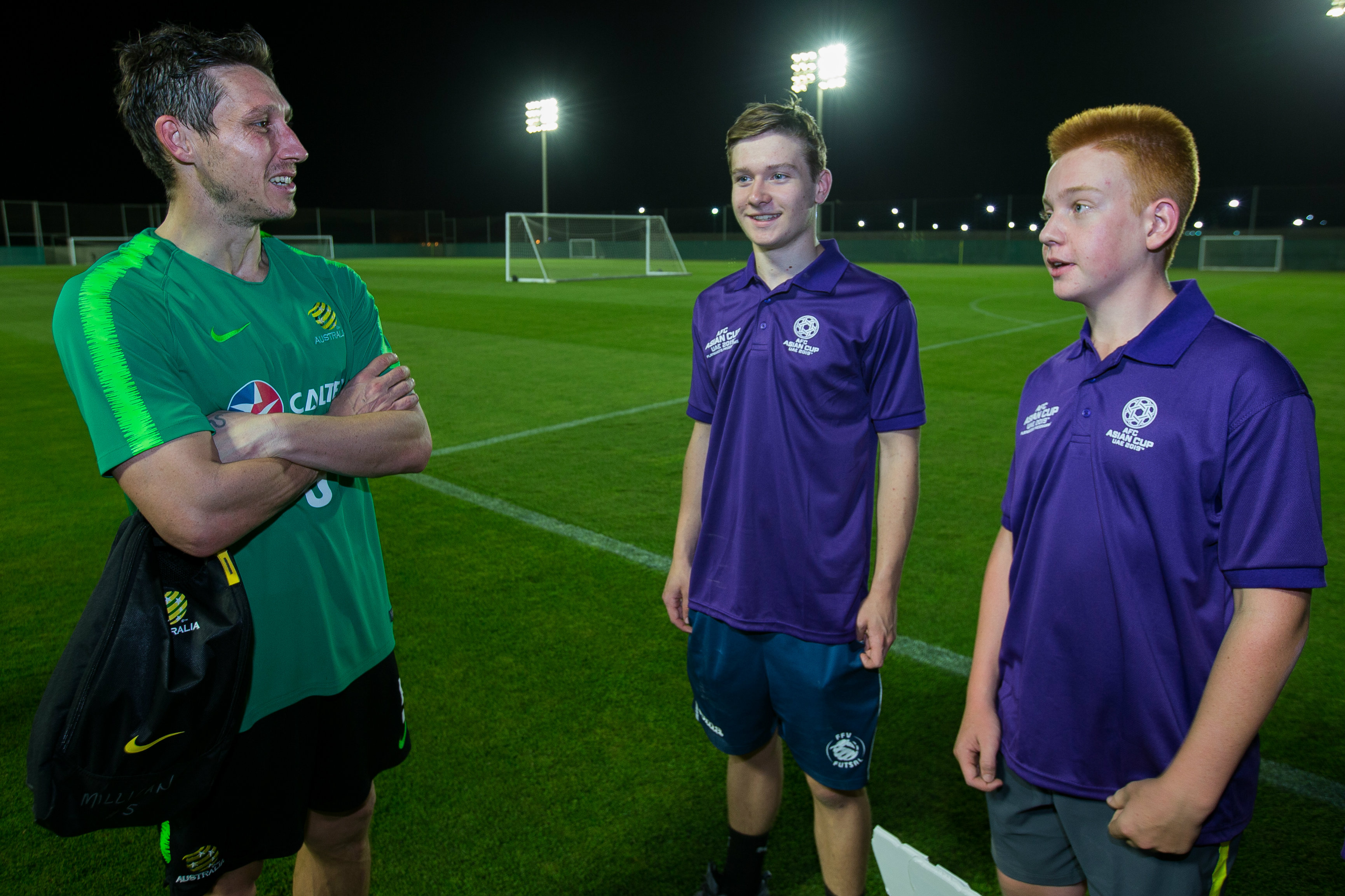 Mark Milligan chats with a couple of youngsters.