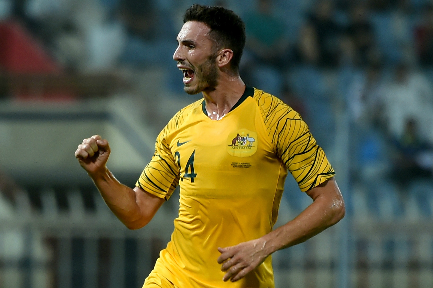 Apostolos Giannou celebrates his first goal for the Caltex Socceroos.