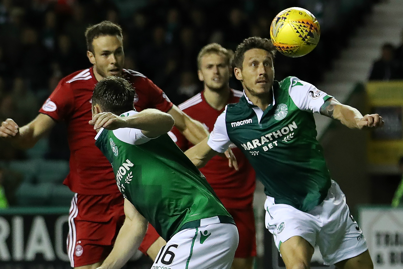 Mark Milligan in action for Hibernian.
