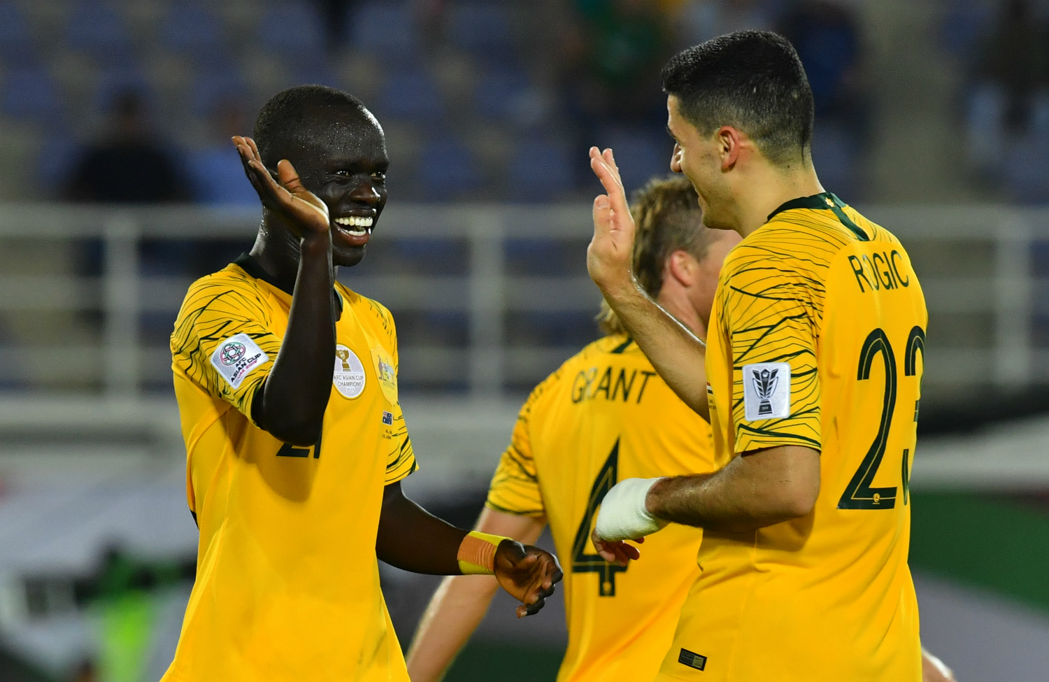 Awer Mabil and Tom Rogic (The AFC)