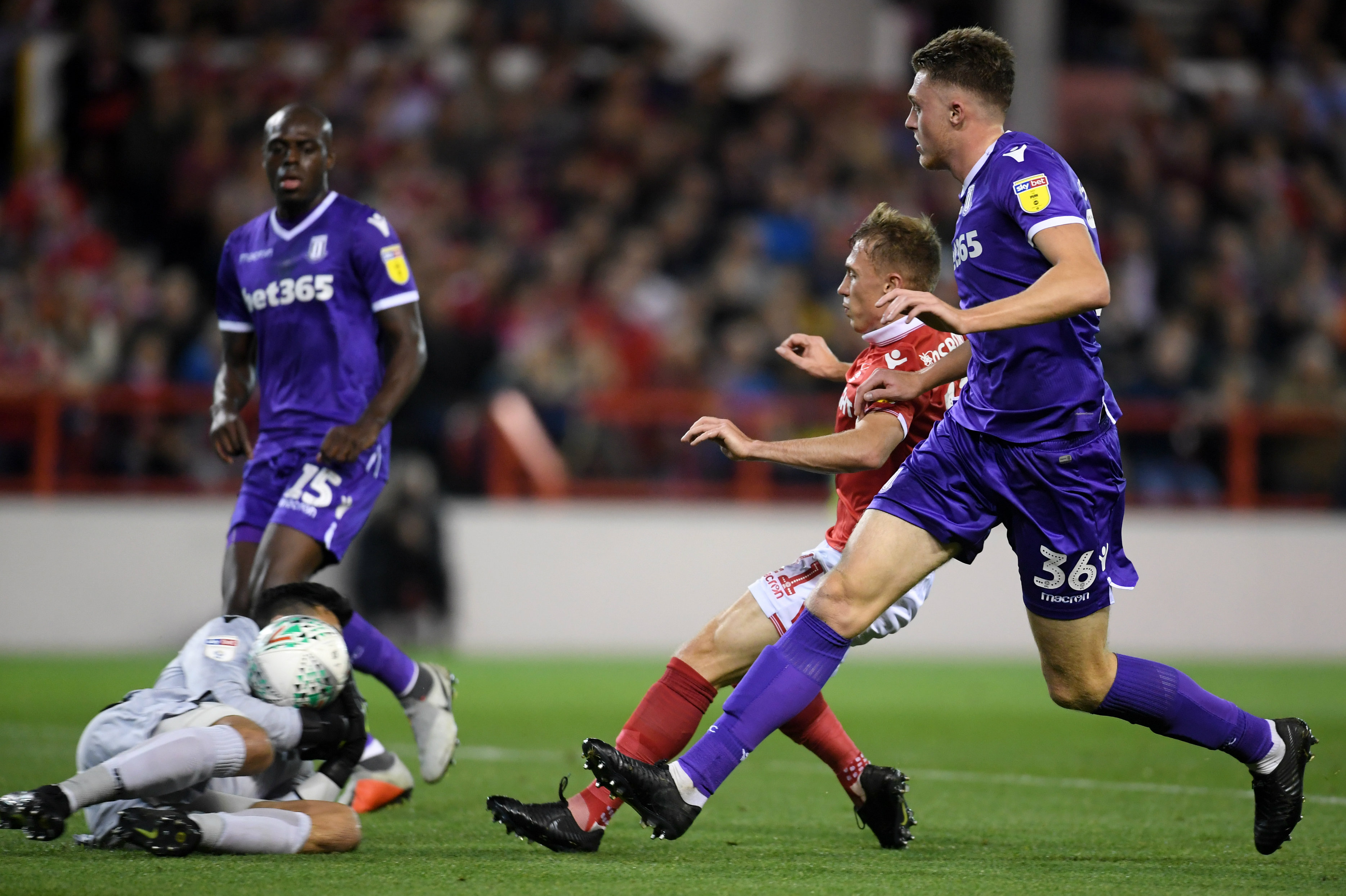 Adam Federici makes a save as Harry Souttar puts pressure on a Nottingham Forest attacker in the League Cup