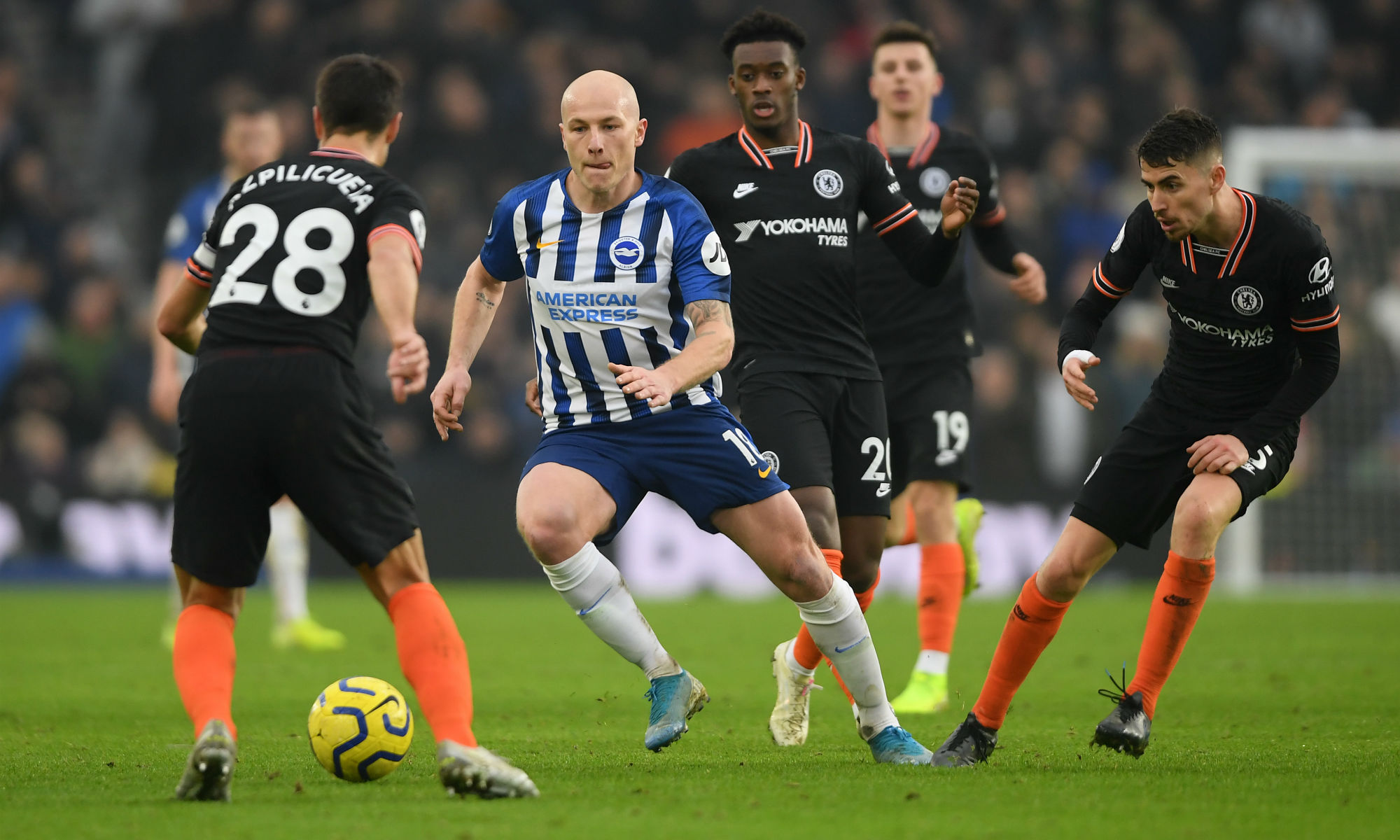 Aaron Mooy is surrounded by Chelsea players as the Caltex Socceroo drives Brighton on at the AMEX Stadium.
