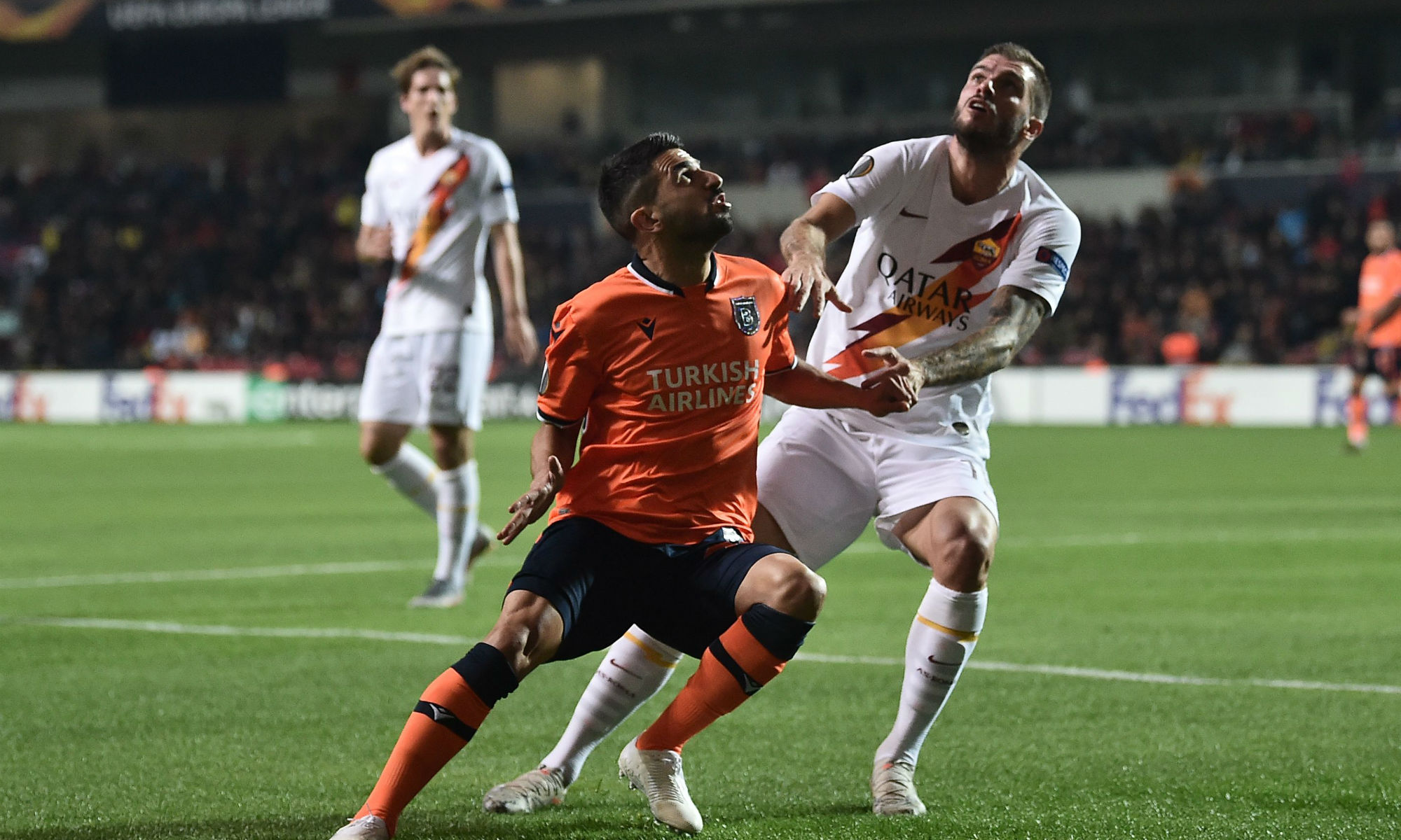Behich tussles for the ball while in action for Istanbul Başakşehir.