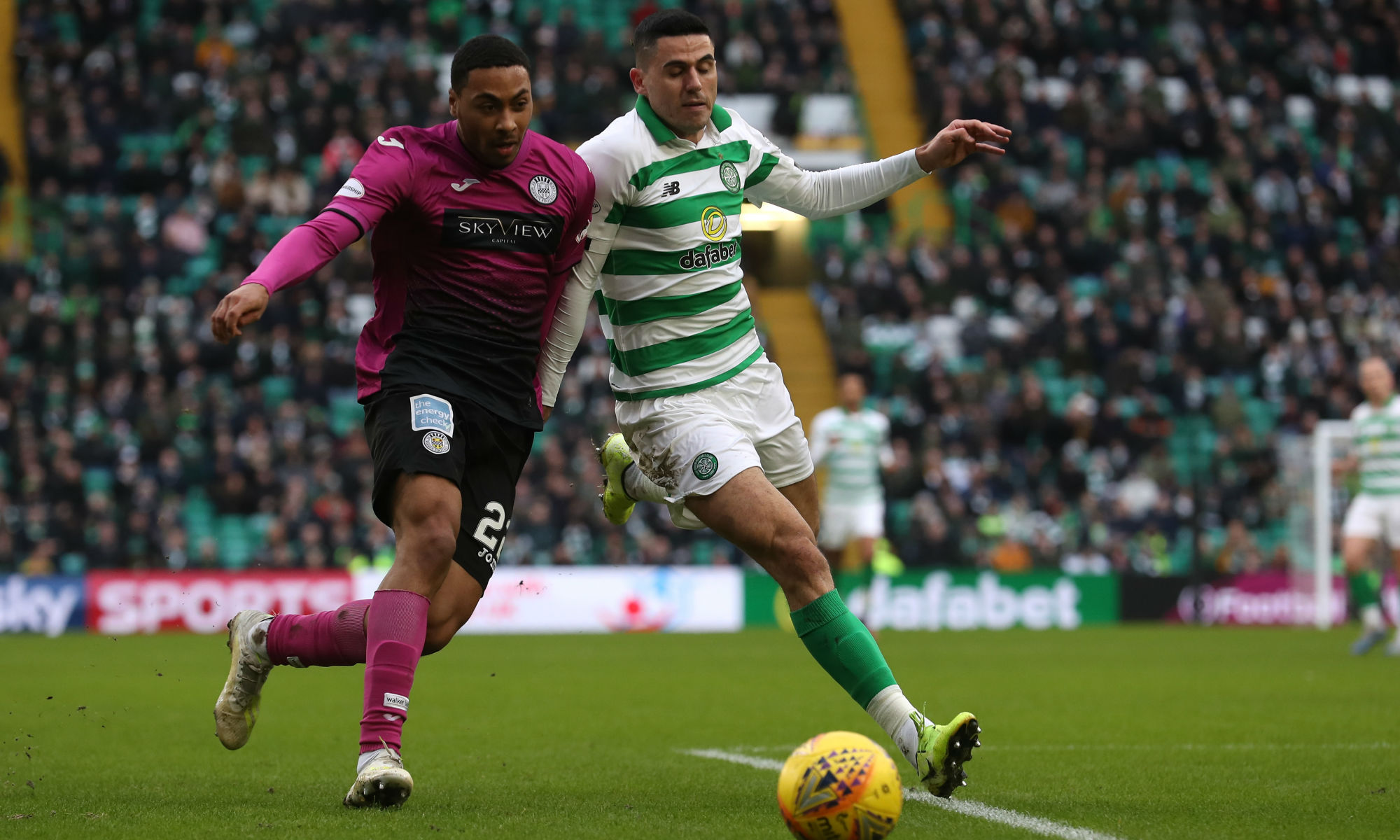 Celtic and Socceroos playmaker Tom Rogic battles for the ball against St Mirren