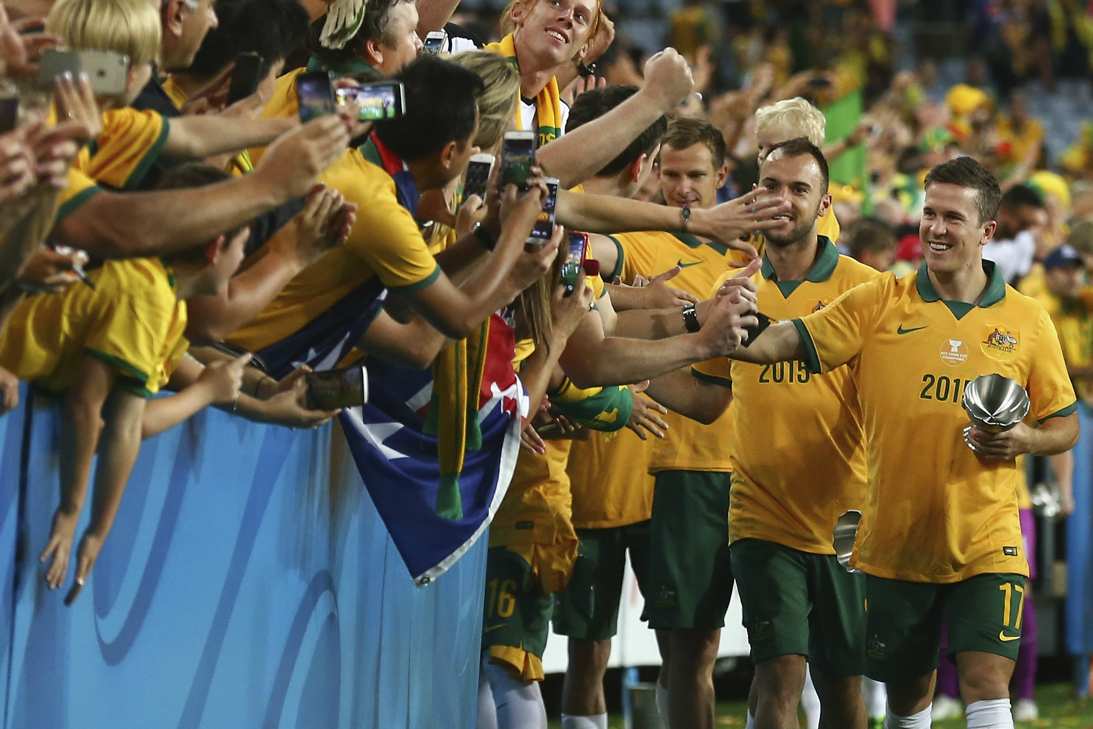 Matt McKay thanks the fans after the Caltex Socceroos 2015 AFC Asian Cup triumph