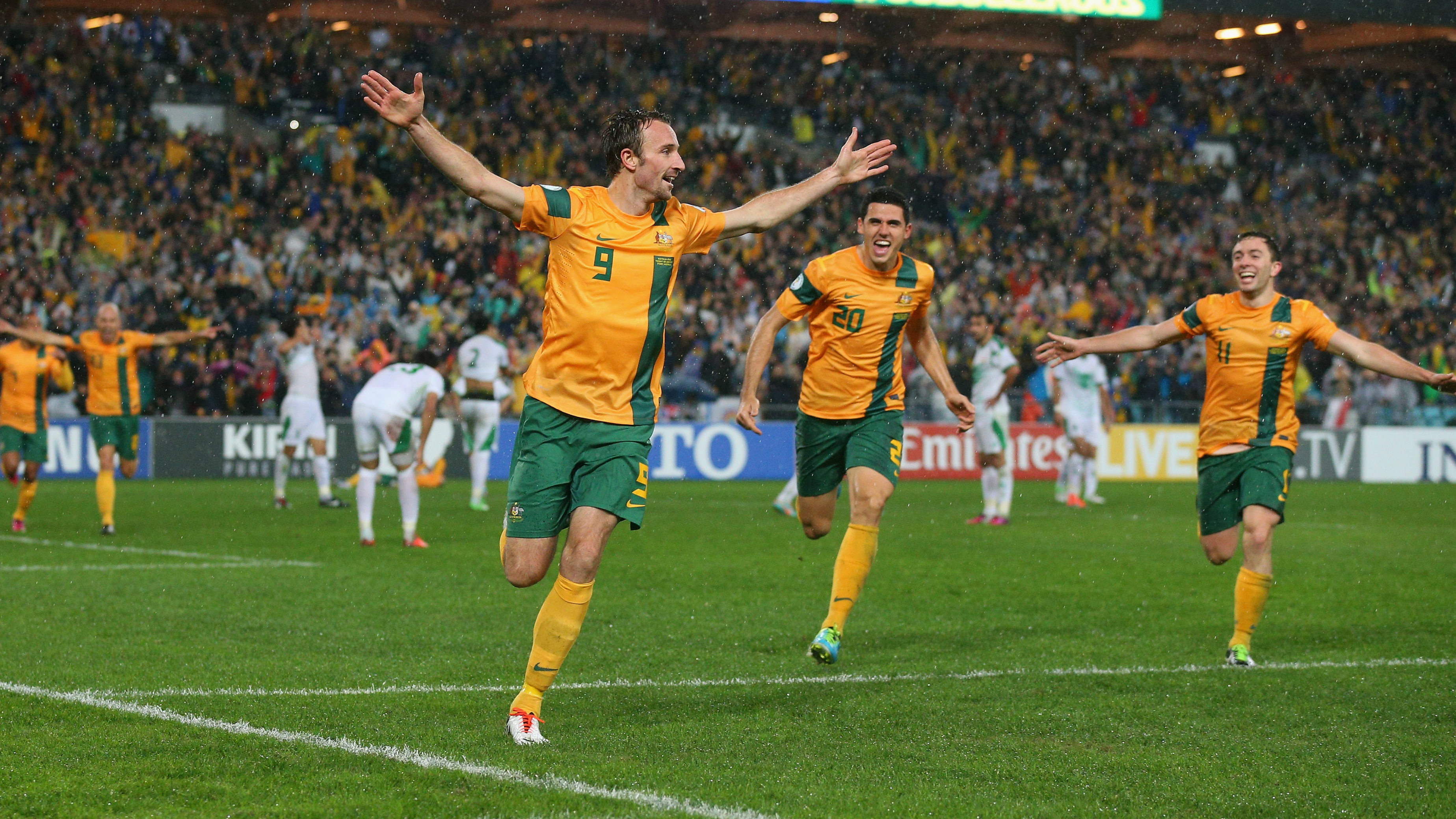 Josh Kennedy's late goal against Iraq in Sydney booked Australia's berth at the 2014 FIFA World Cup in Brazil.