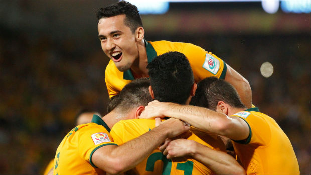 The Socceroos celebrate Robbie Kruse scoring against Oman.