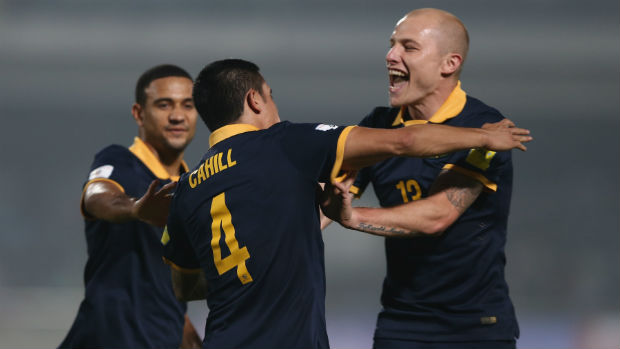 Socceroos James Meredith, Tim Cahill and Aaron Mooy celebrate scoring against Bangladesh in Dhaka.