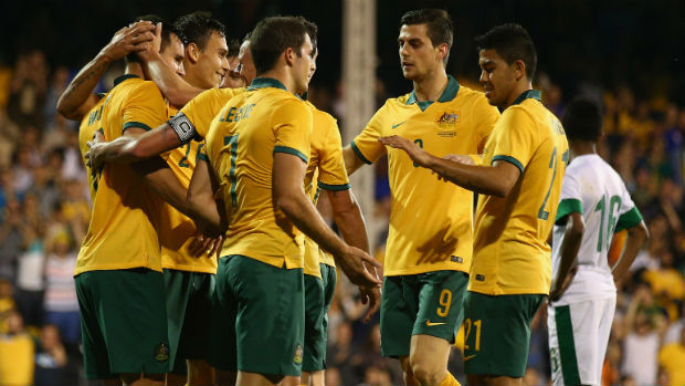 Massimo Luongo among Socceroos congratulating Bailey Wright on his maiden international goal.