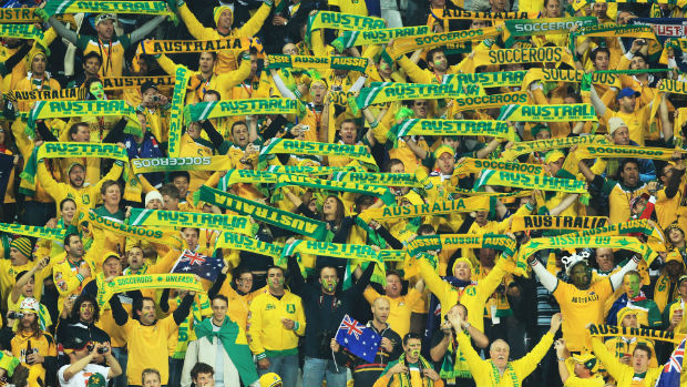 Socceroos fans show their green and gold support.