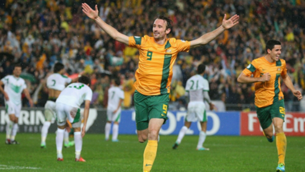 Josh Kennedy celebrates his header against Iraq which sent Australia to the 2014 World Cup.