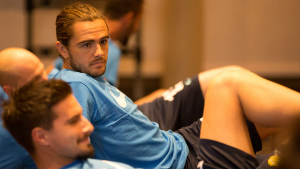 Caltex Socceroos defender Josh Risdon goes through his stretches in camp.