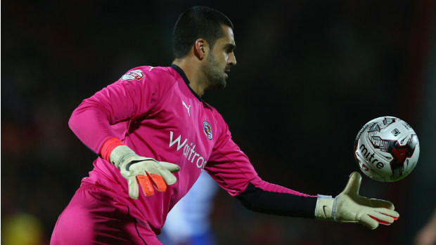 Reading's Adam Federici fires a kick up field in the Championship.
