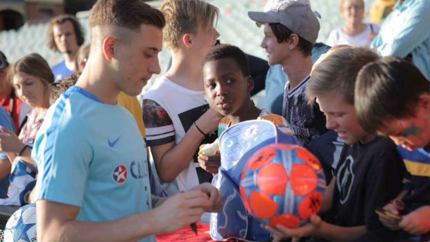 Defender Alex Gersbach sign autographs at the Caltex Socceroos' Fan Day in Adelaide.