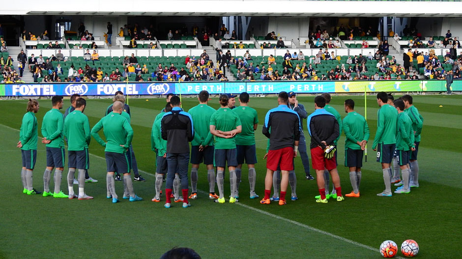 Socceroos players are given instructions from Ange Postecoglou during the session at nib Stadium.