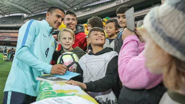 Caltex Socceroos striker Tim Cahill poses for a photo with fans at the team's Fan Day in Adelaide.