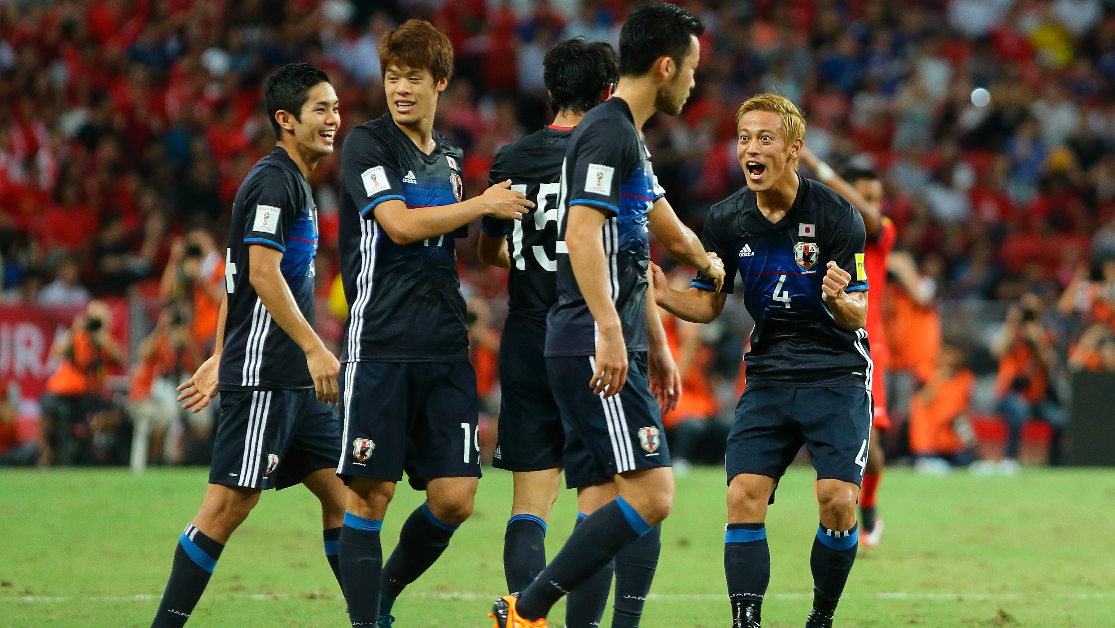 Keisuke Honda (right) has urged Japan to take a 'bold' approach against the Caltex Socceroos.