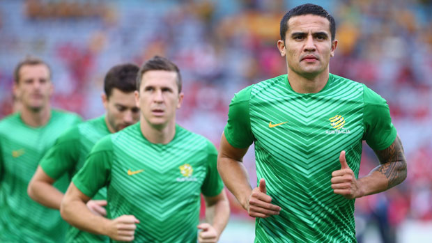 Tim Cahill warms up before  a Socceroos match.