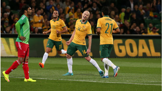 Socceroos midfielder Aaron Mooy celebrates scoring against Bangladesh.
