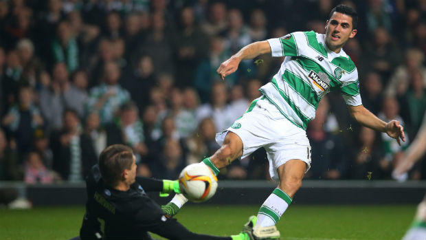 Tom Rogic has a shot on goal for Celtic in the Europa League.